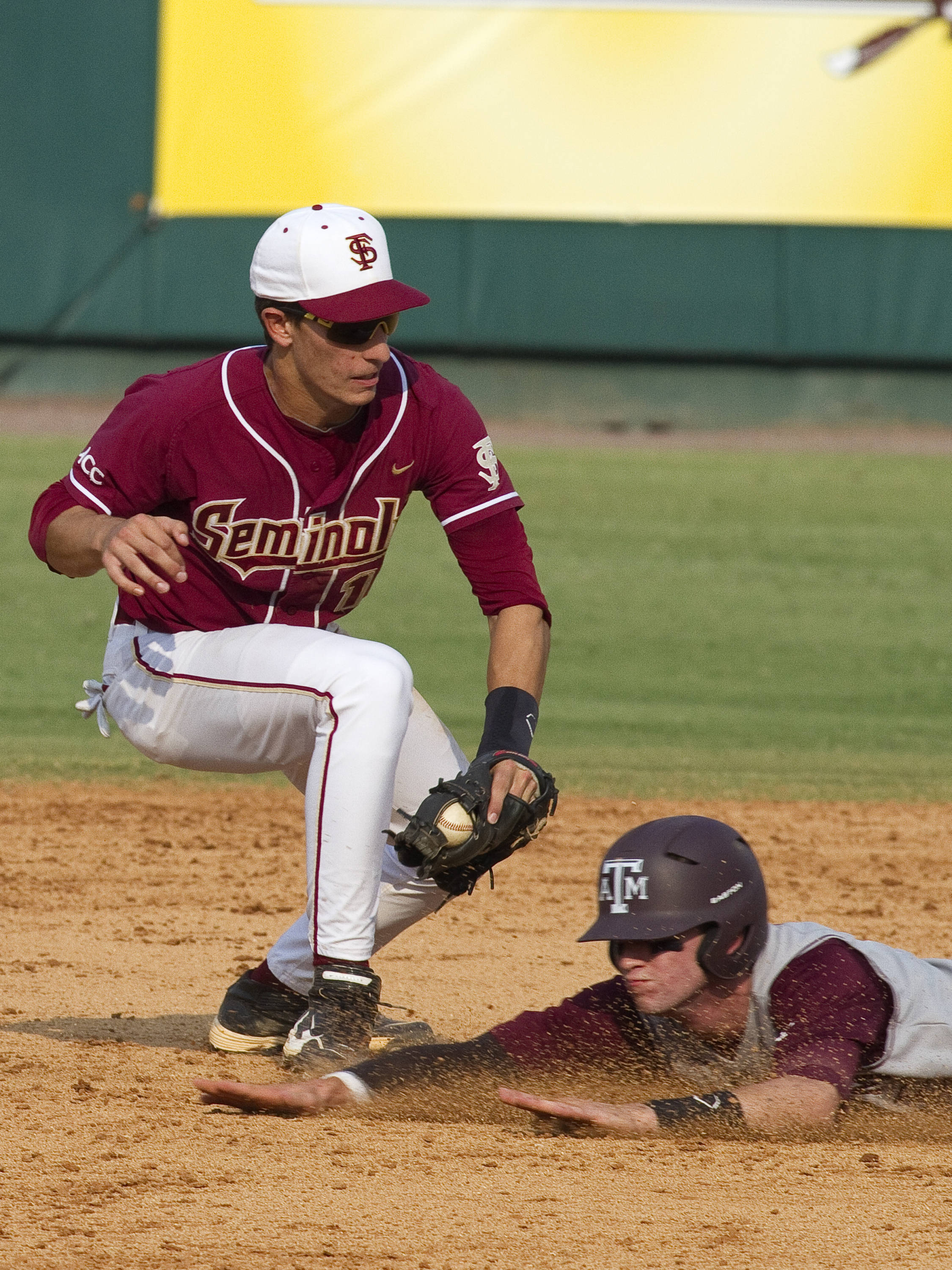 Shortstop Justin Gonzalez (10) tagging out a Texas A&M runner on an attempted steal