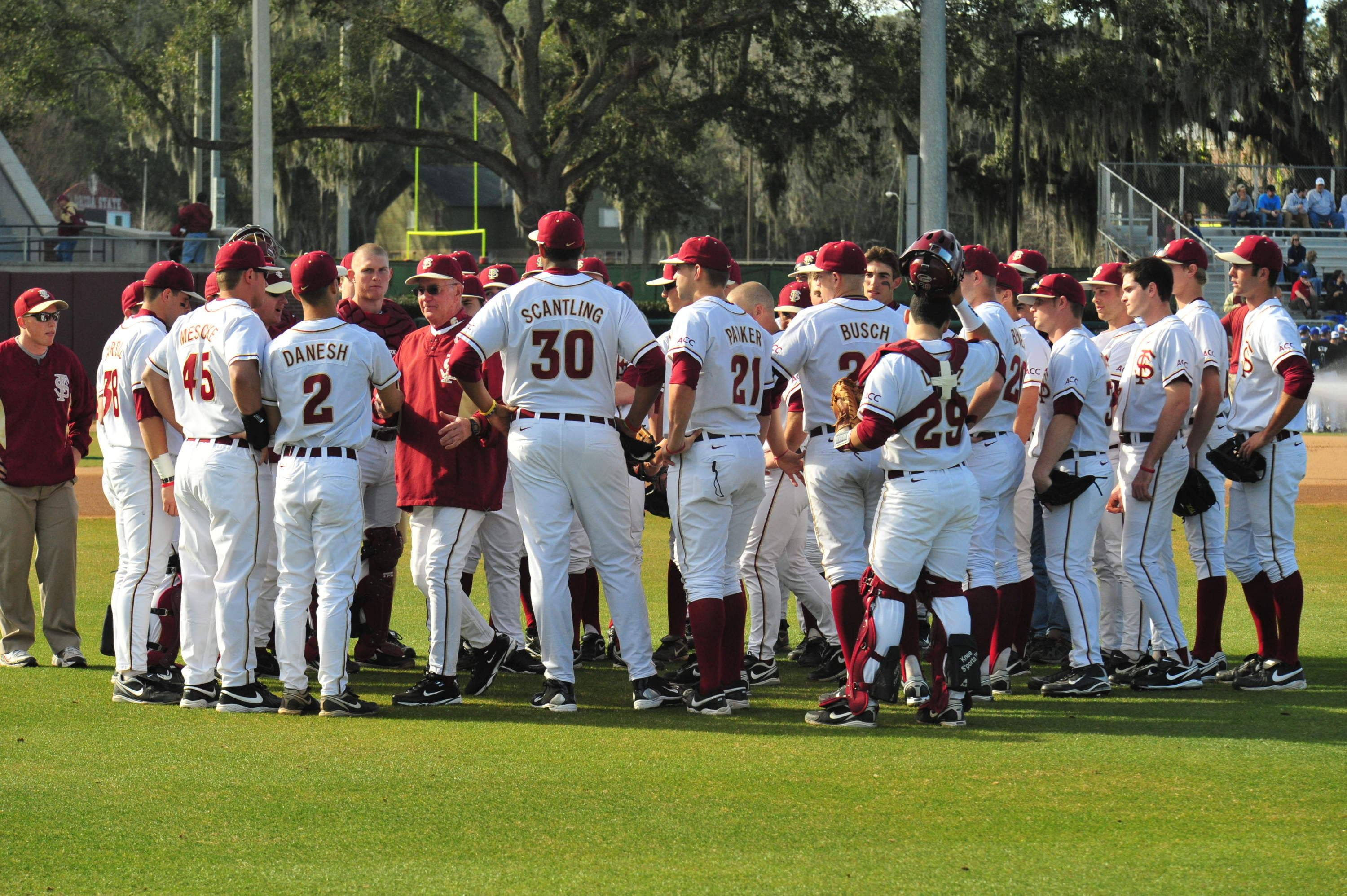 The 2010 Seminoles huddle before the start of opening day on Friday night in Tallahassee against Georgia State.