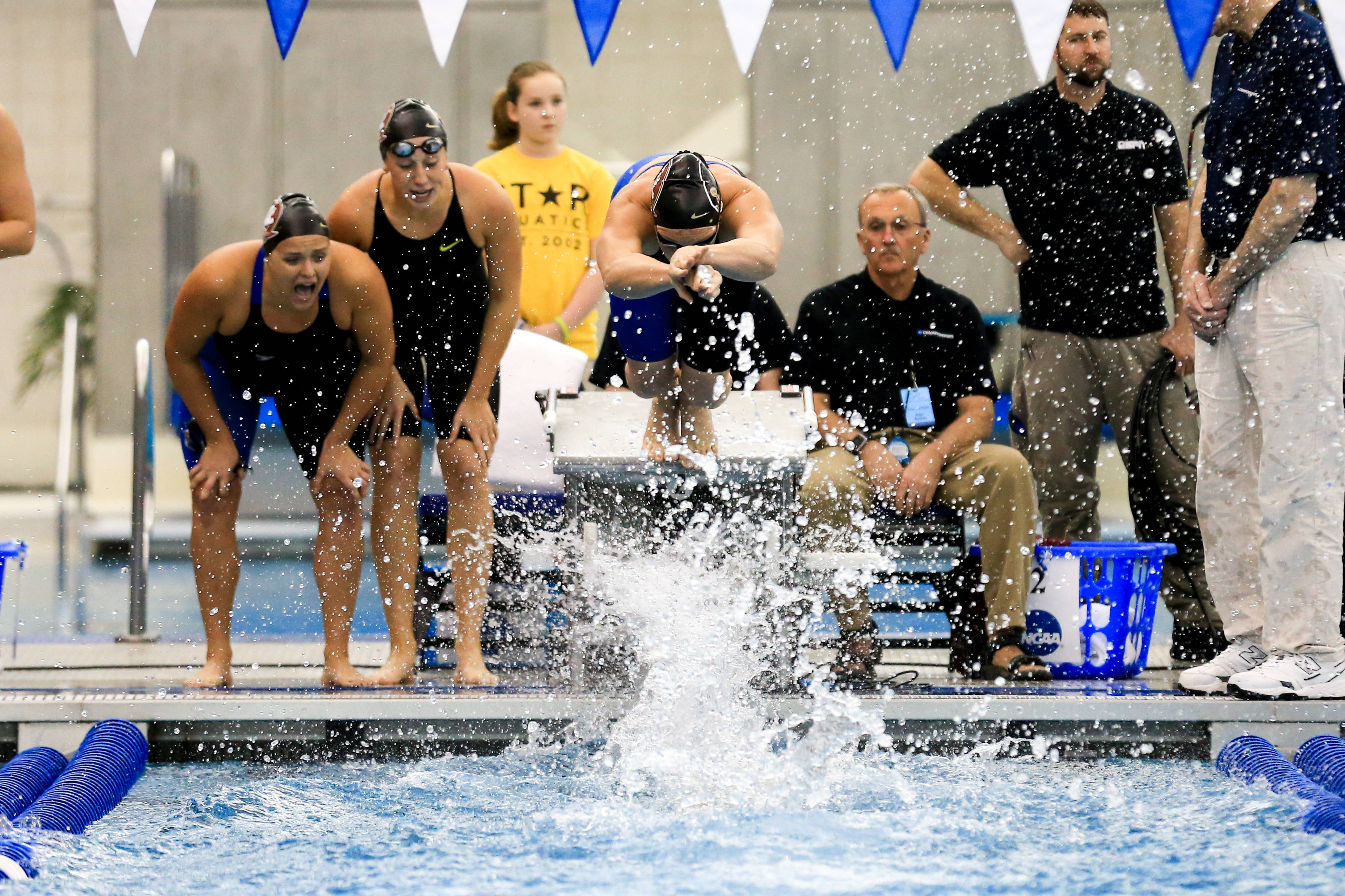 Bianca Spinazzola and Natalie Pierce cheer on their teammates in the 200 medley relay.