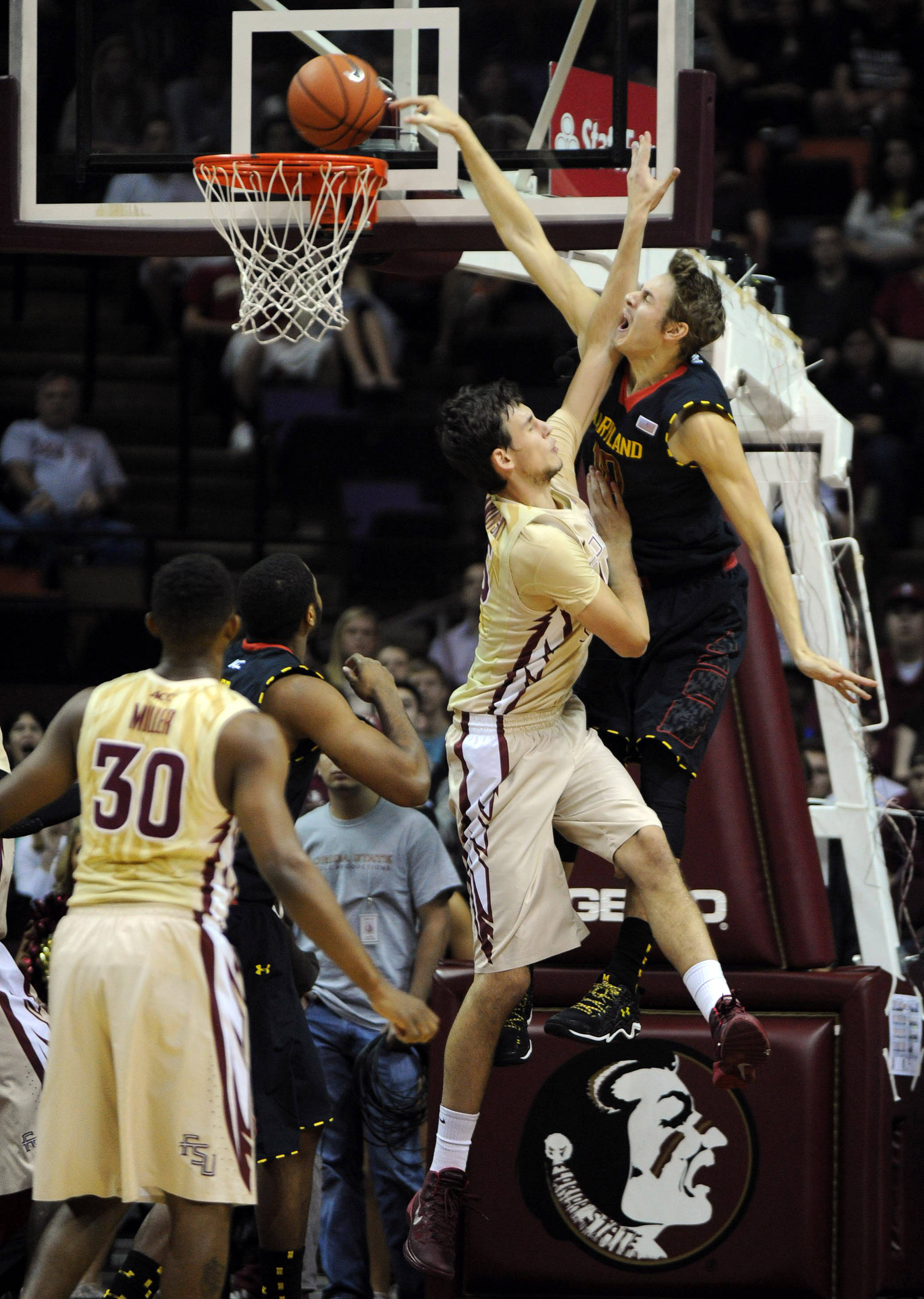 Jan 12, 2014; Tallahassee, FL, USA; Maryland Terrapins forward Jake Layman (10) misses a dunk as he is defended by Florida State Seminoles forward Boris Bojanovsky (15) during the first half of the game at the Donald L. Tucker Center. Mandatory Credit: Melina Vastola-USA TODAY Sports