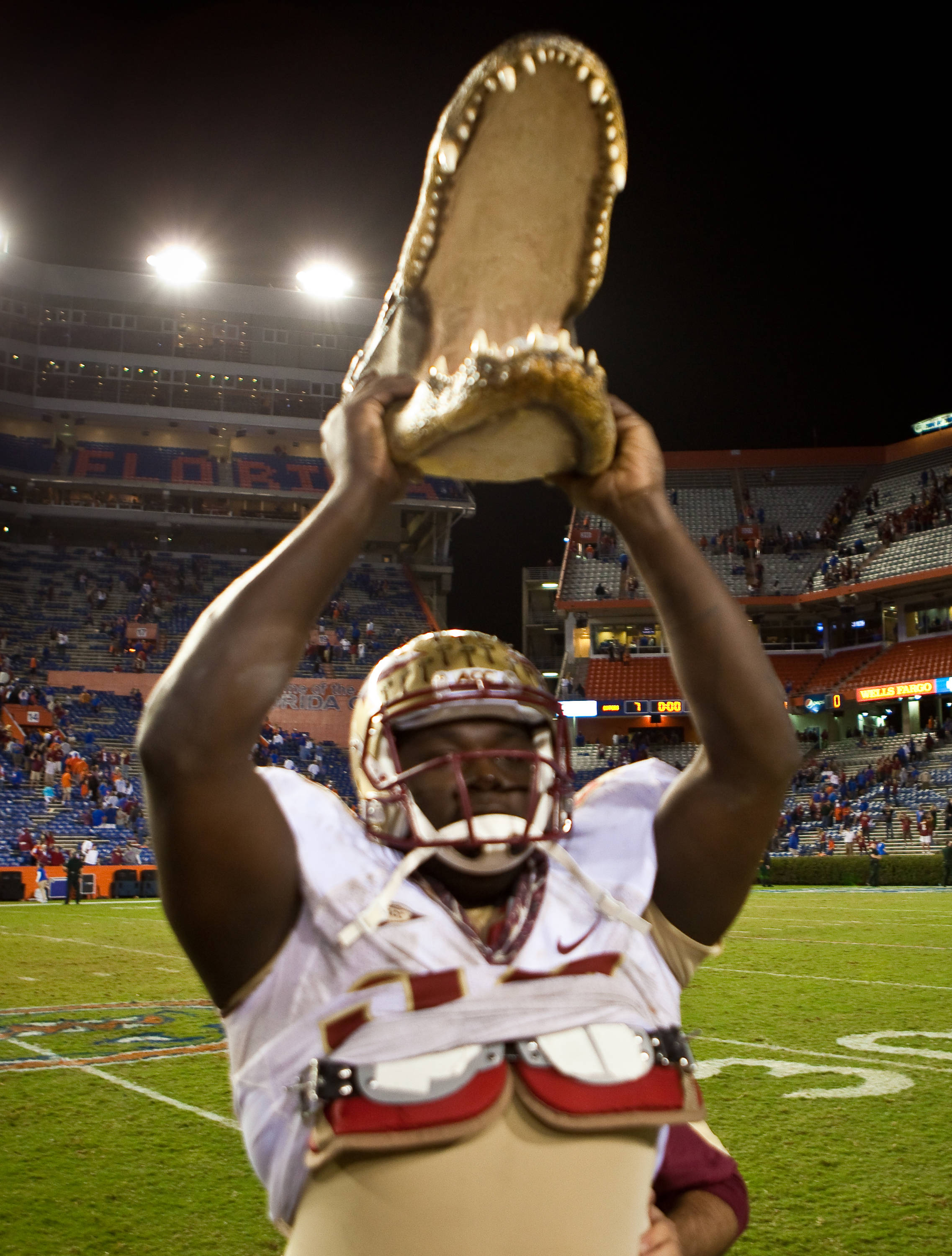 Anthony McCloud (92) hoists the Gator Head high after the Seminoles' victory over the Gators in the Gainesville