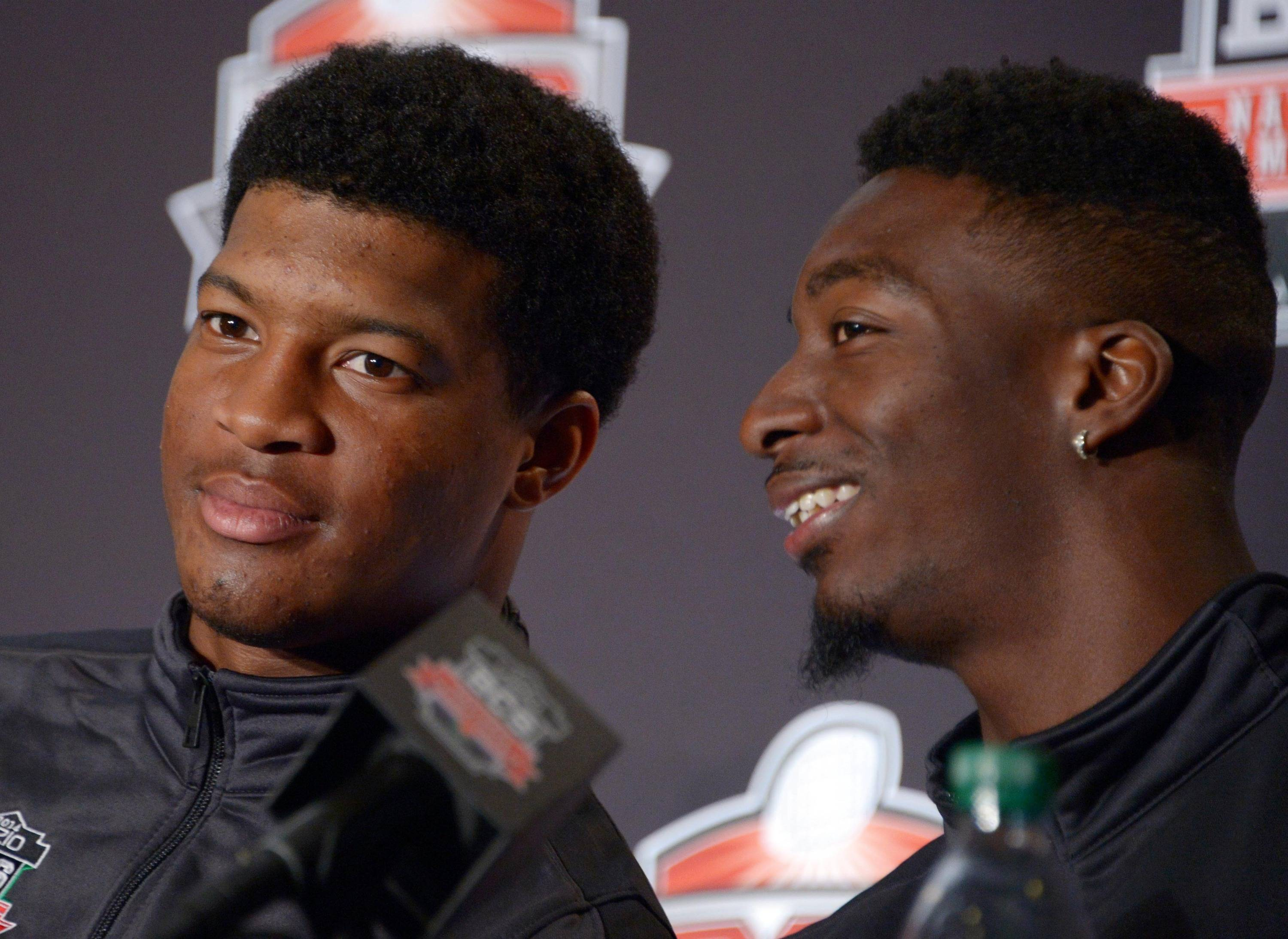 Florida State Seminoles quarterback Jameis Winston (left) and receiver Kenny Shaw at a 2014 BCS National Championship press conference at Newport Beach Marriott. Mandatory Credit: Kirby Lee-USA TODAY Sports