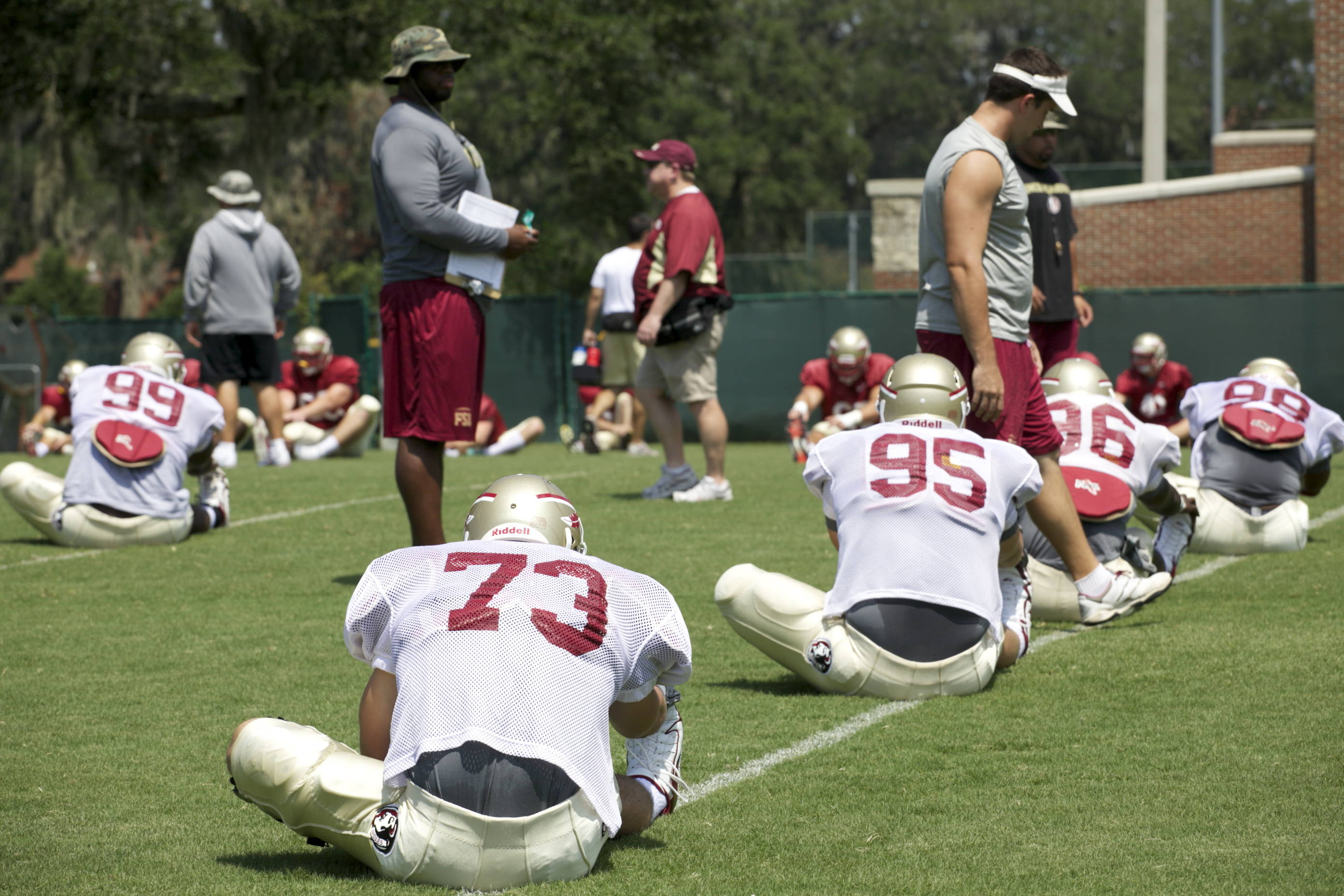 Defense stretching before practice