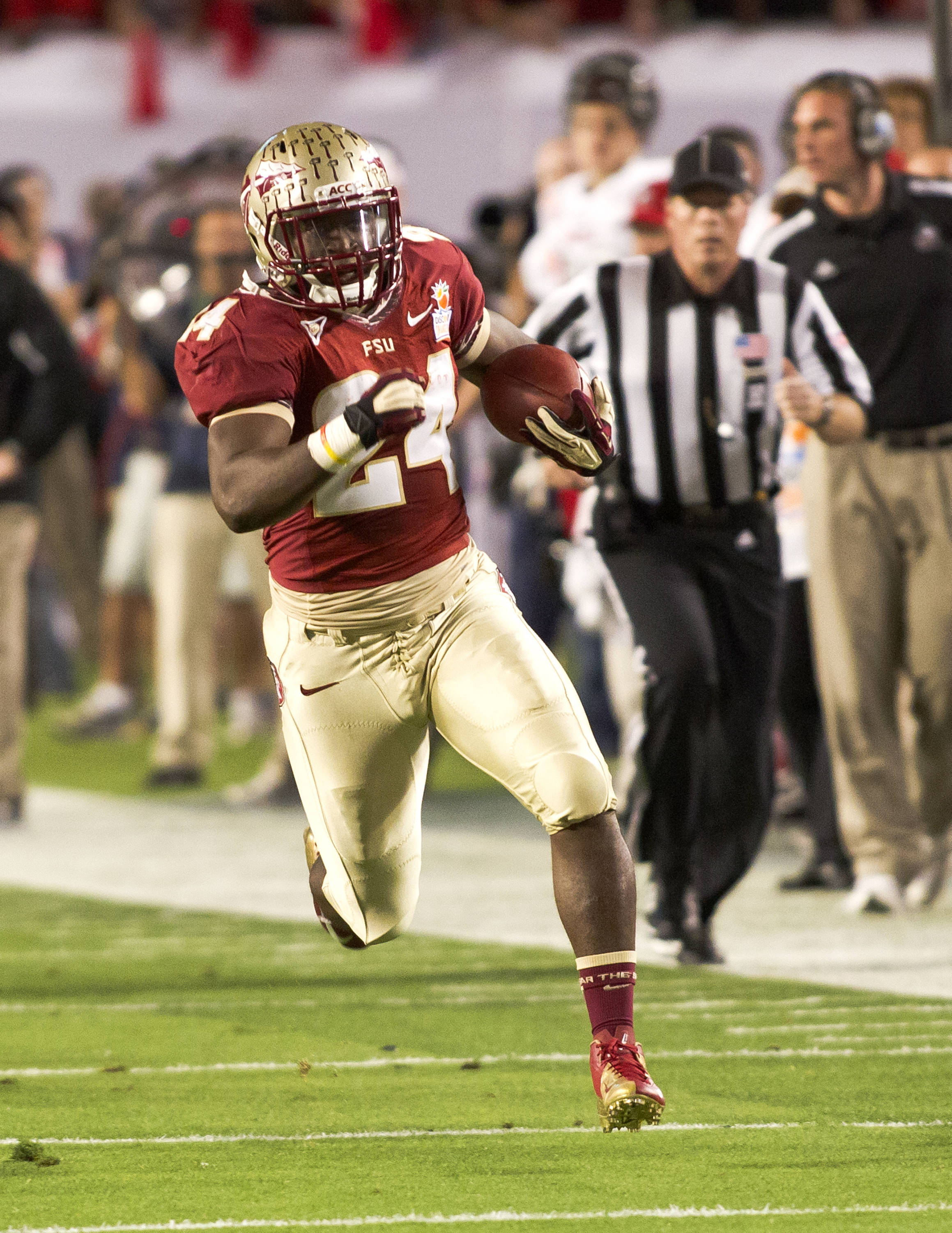 Lonnie Pryor (24) on a 60 yard touchdown run, FSU vs No. Illinois, 01/01/13. (Photo by Steve Musco)