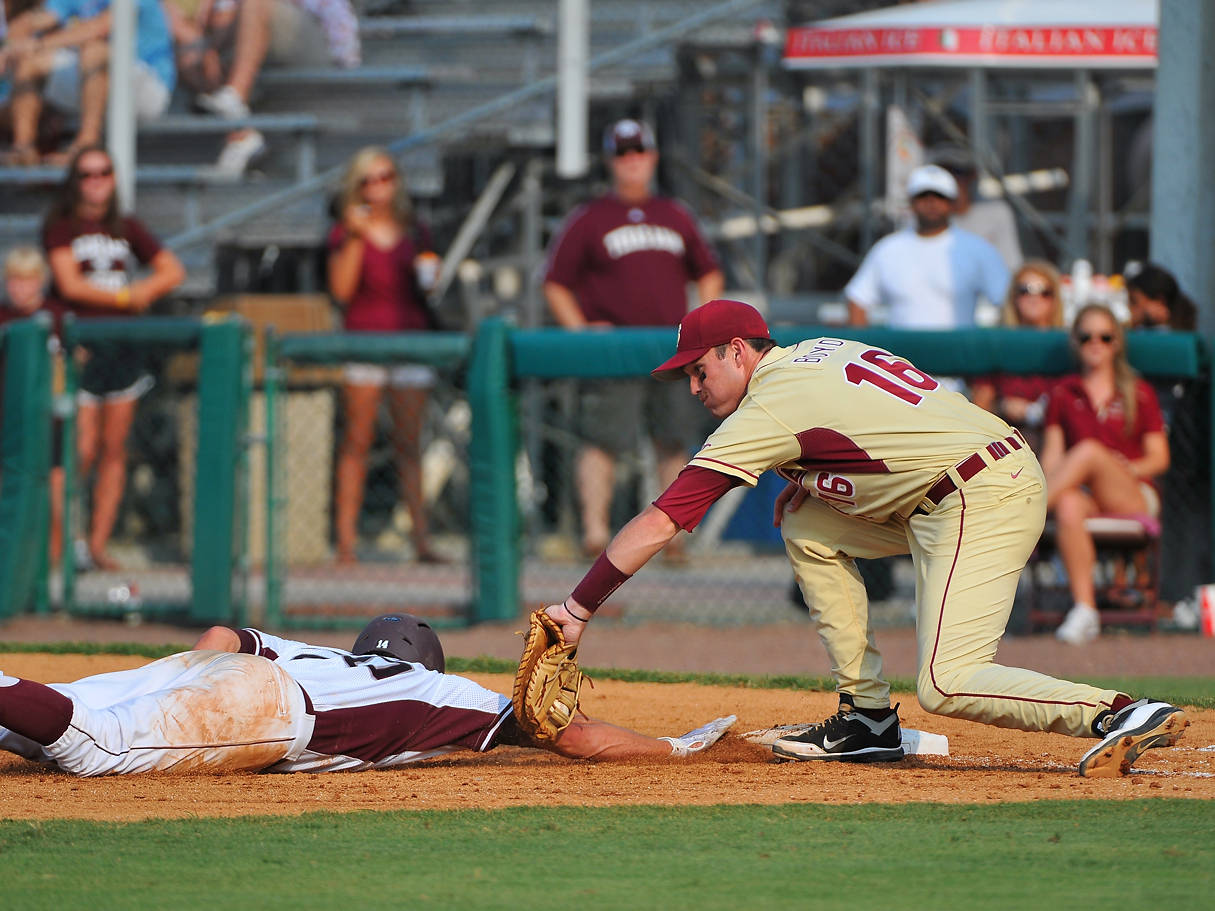First baseman Jayce Boyd slaps a tag on a Texas A&M baserunner during a failed - but close - pickoff attempt.