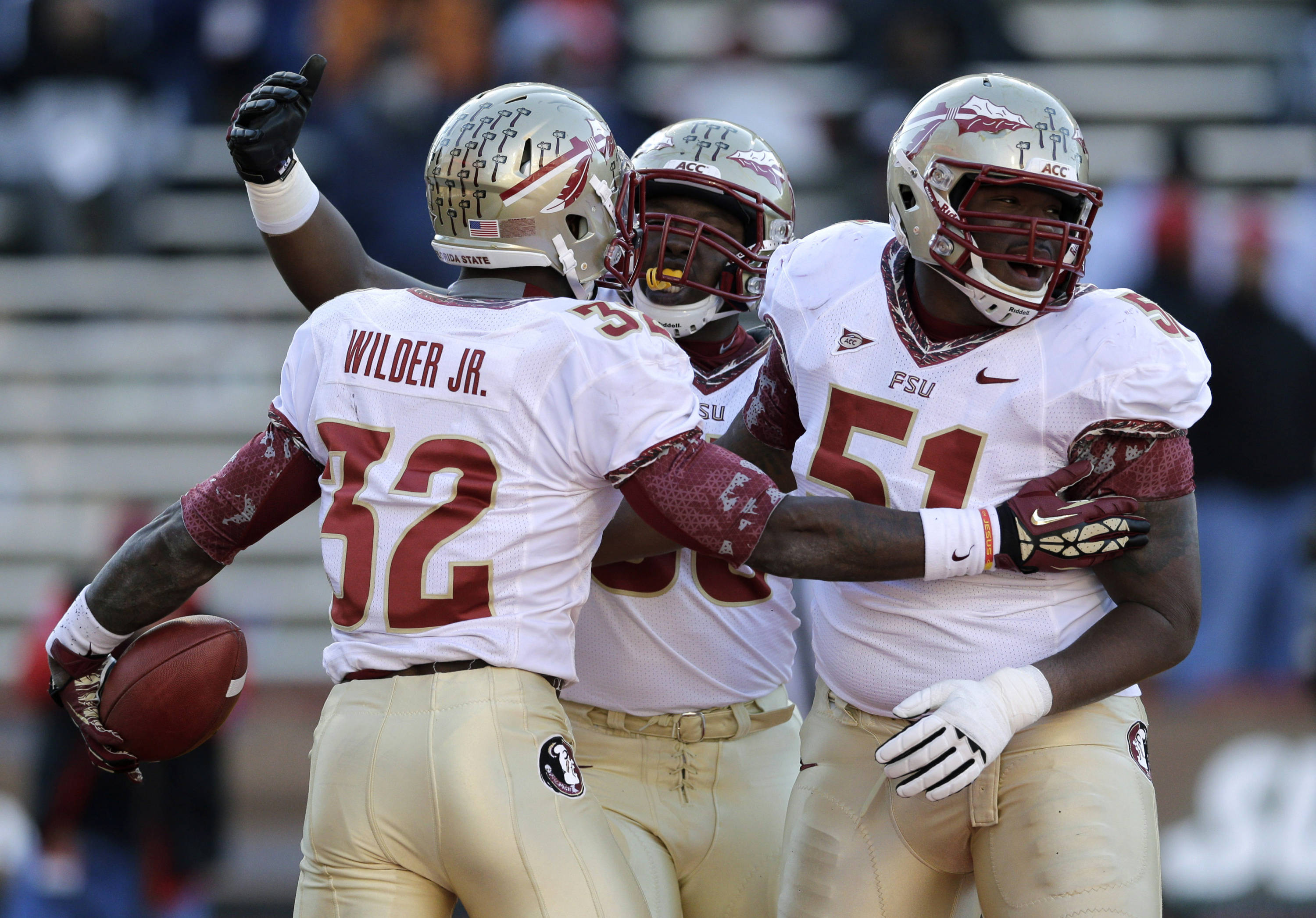 Running back James Wilder, Jr. celebrates his touchdown with teammates Ruben Carter and Bobby Hart in the second half of an NCAA college football game against Maryland in College Park, Md., Saturday, Nov. 17, 2012. Florida State won 41-14. (AP Photo/Patrick Semansky)