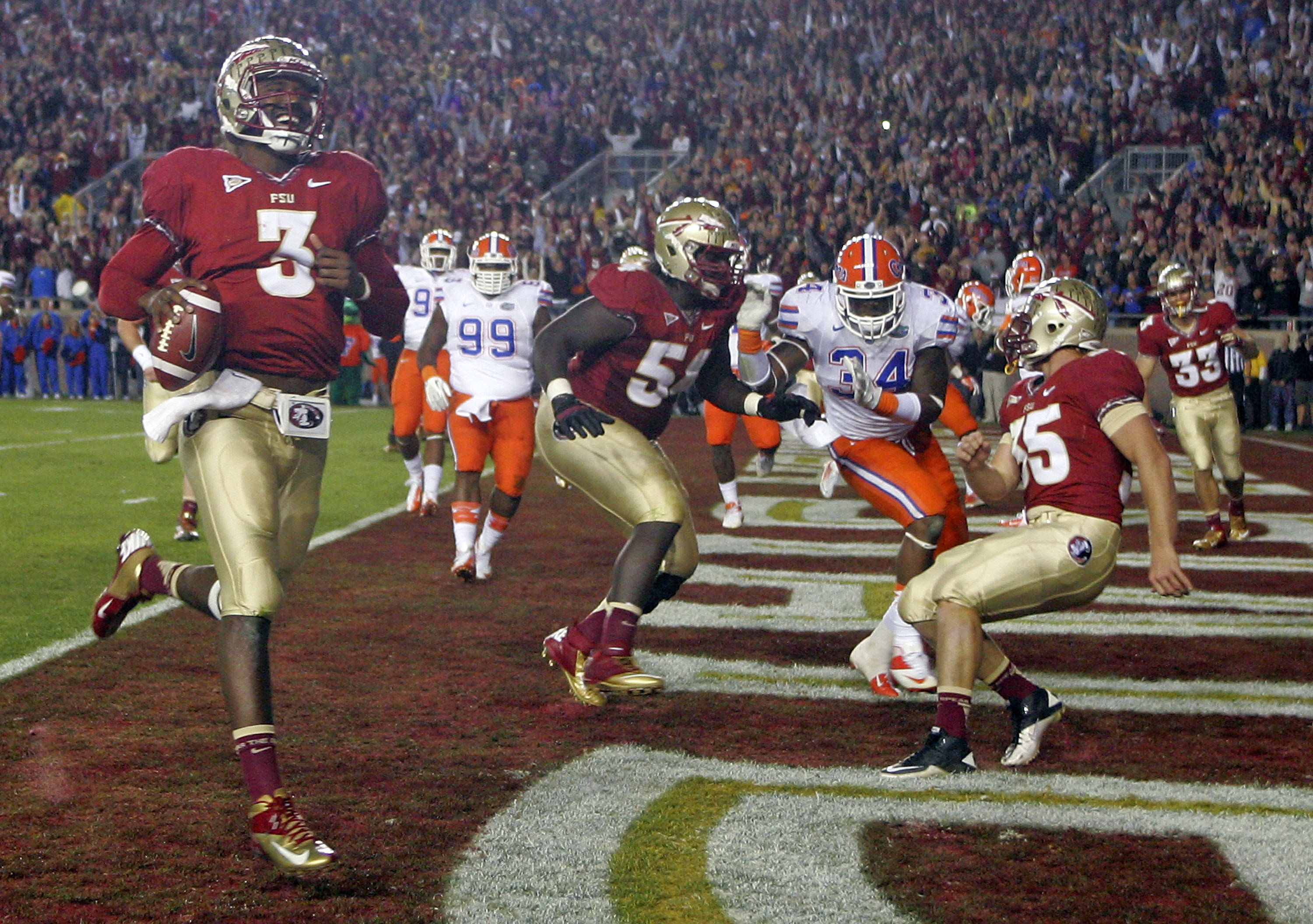 Florida State quarterback EJ Manuel (3) smiles as he scores a touchdown. (AP Photo/Phil Sears)
