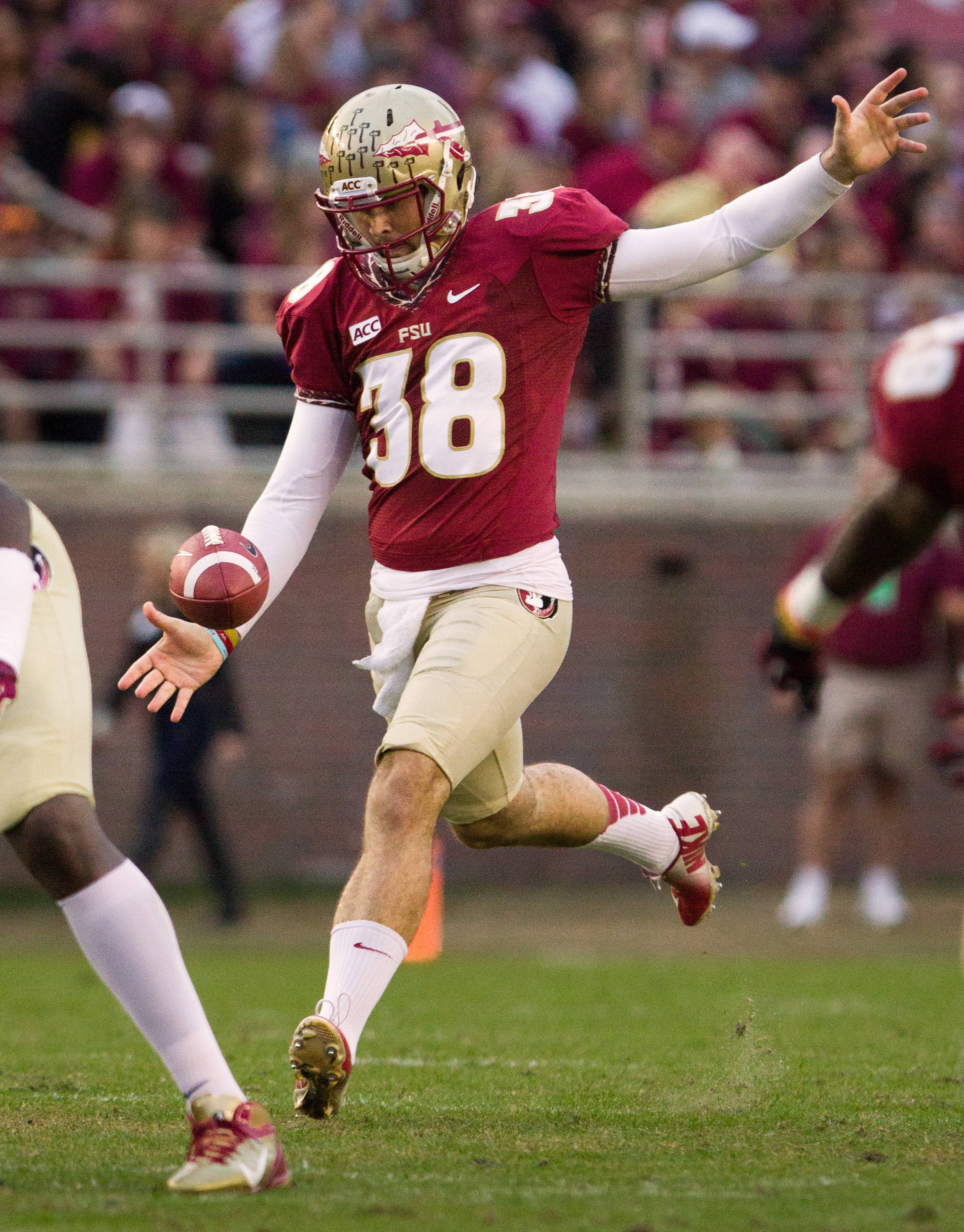 Cason Beatty (38) punts during FSU Football's 59-3 win over Syracuse on Saturday, November 16, 2013 in Tallahassee, Fla. Photo by Mike Schwarz.