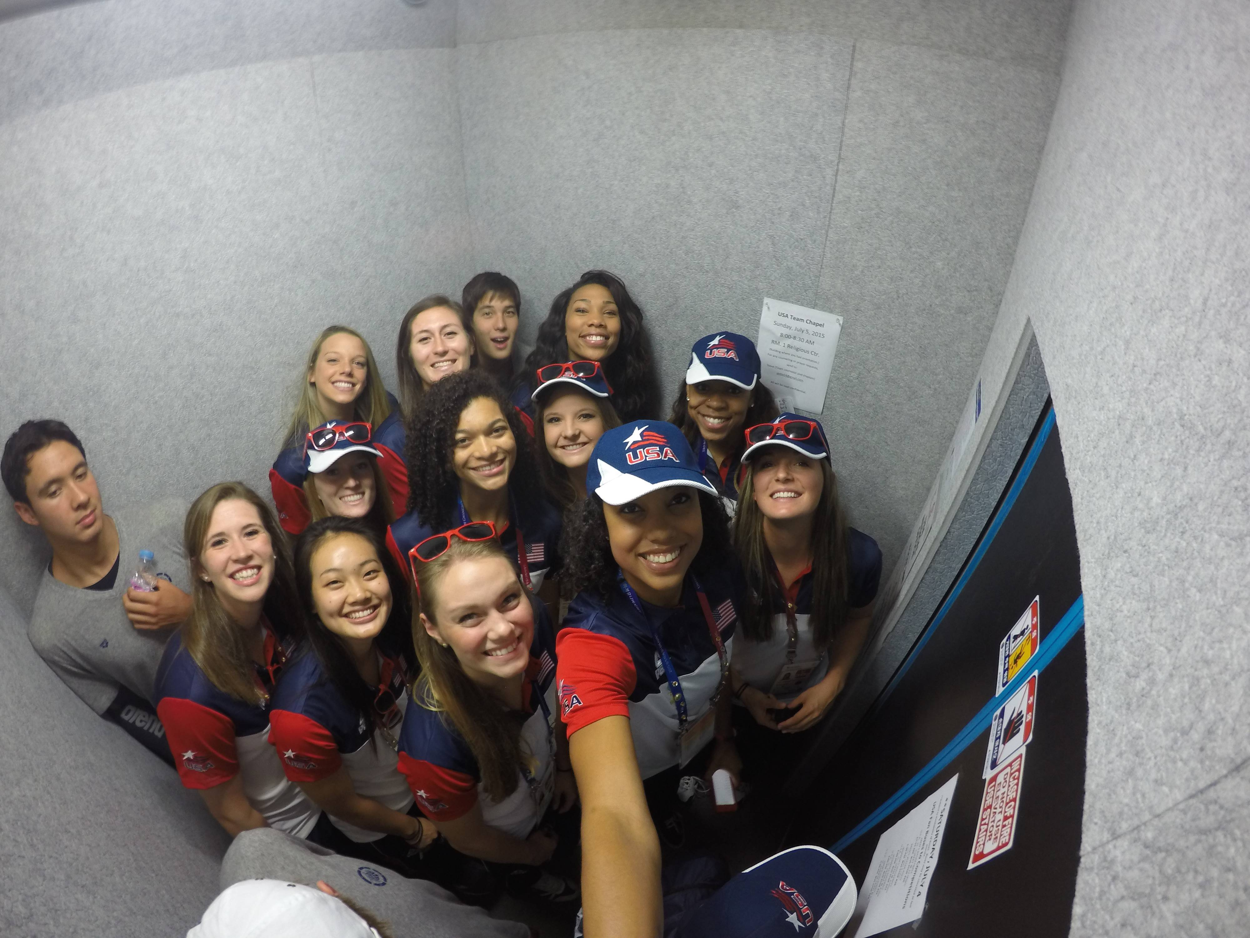 Team USA volleyball poses in an elevator.