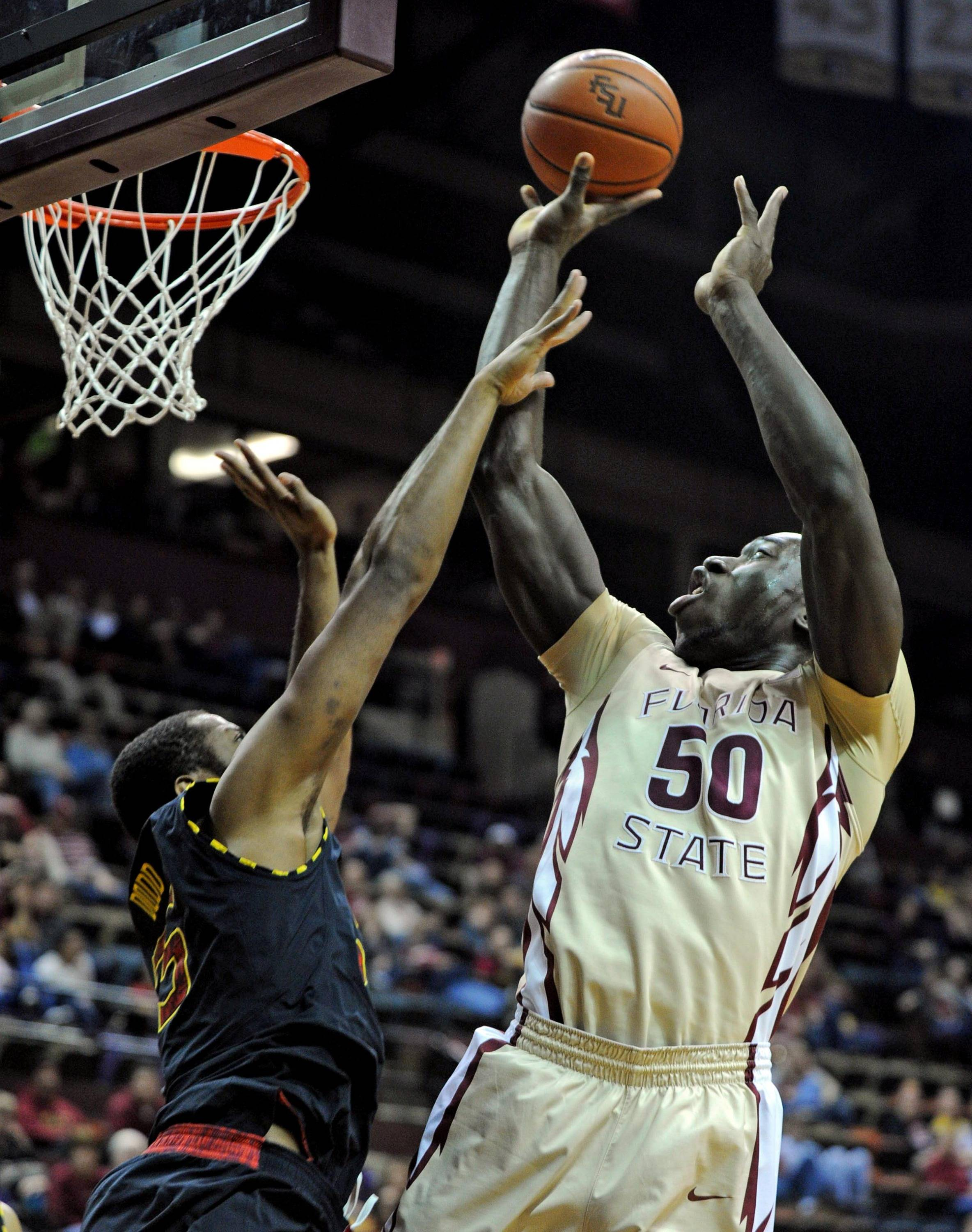 Jan 12, 2014; Tallahassee, FL, USA; Florida State Seminoles center Michael Ojo (50) looks to shoot as he is defended by Maryland Terrapins forward Damonte Dodd (35) during the second half at Donald L. Tucker Center. Mandatory Credit: Melina Vastola-USA TODAY Sports