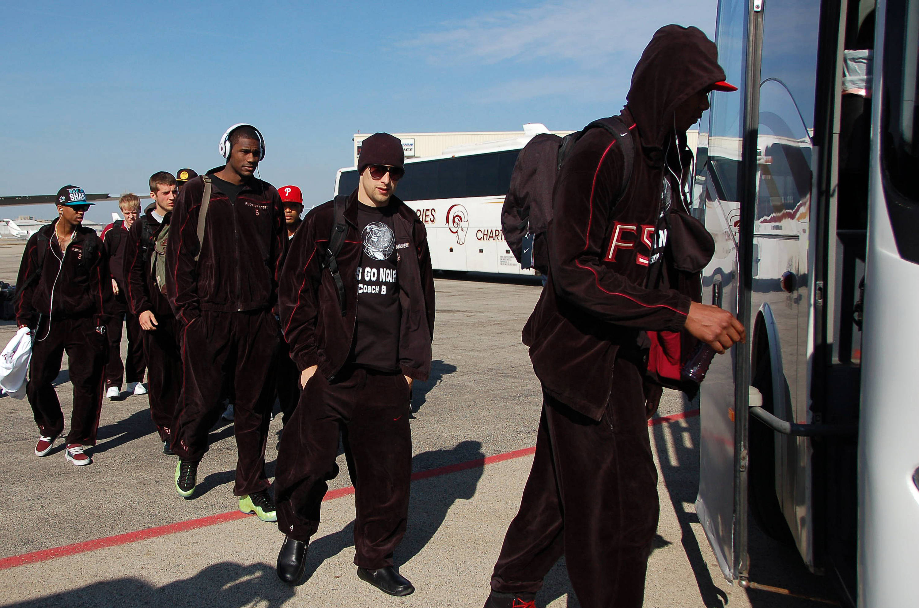 Seminole players load the bus at Midway Airport in Chicago.
