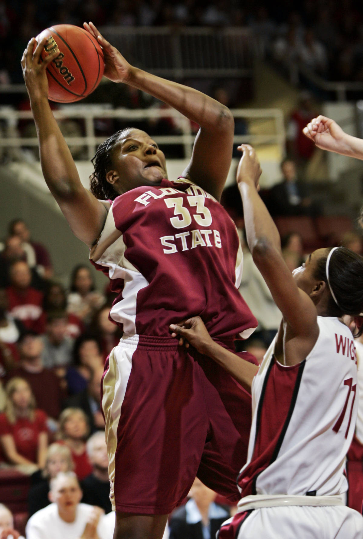 Florida State center Britany Miller (33) scores in front of Stanford guard Candice Wiggins, right, in the first half of their second-round game in the NCAA women's basketball tournament in Stanford, Calif., Monday, March 19, 2007. (AP Photo/Paul Sakuma)