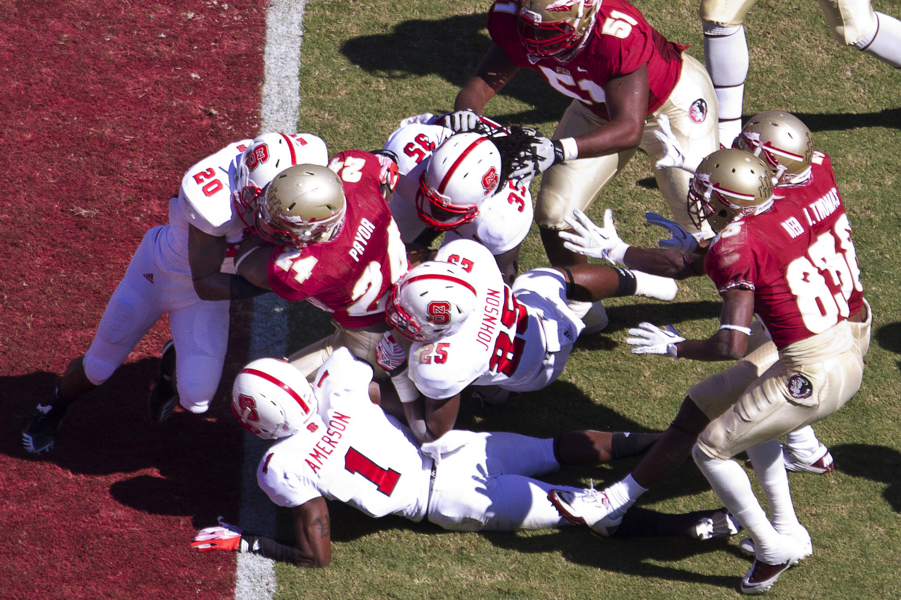 Lonnie Pryor (24) carries the ball through NC State defenders for a touchdown during the football game against NC State October 29, 2011.