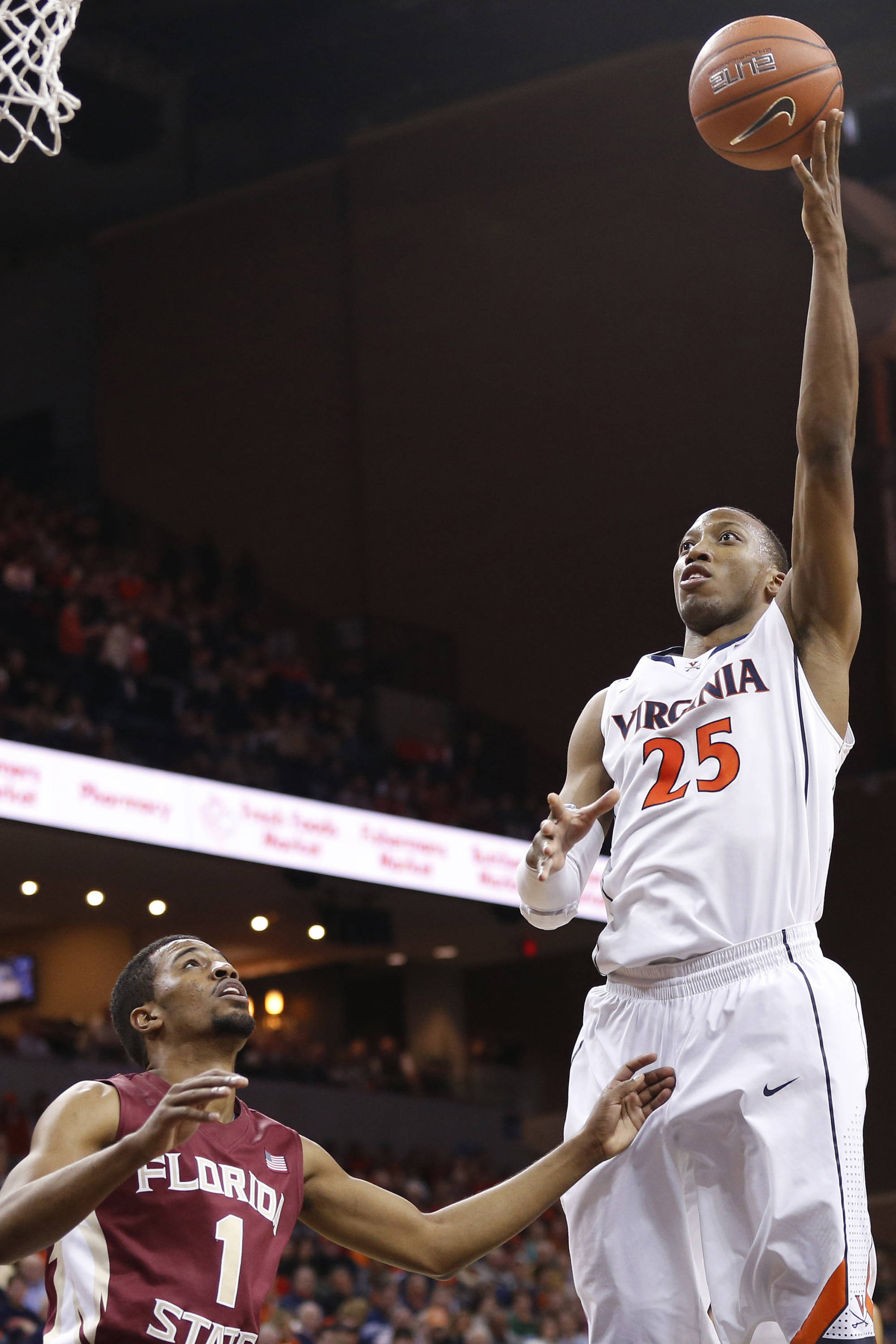 Jan 18, 2014; Charlottesville, VA, USA; Virginia Cavaliers forward Akil Mitchell (25) shoots the ball over Florida State Seminoles guard Devon Bookert (1) in the second half at John Paul Jones Arena. The Cavaliers won 78-66. Mandatory Credit: Geoff Burke-USA TODAY Sports