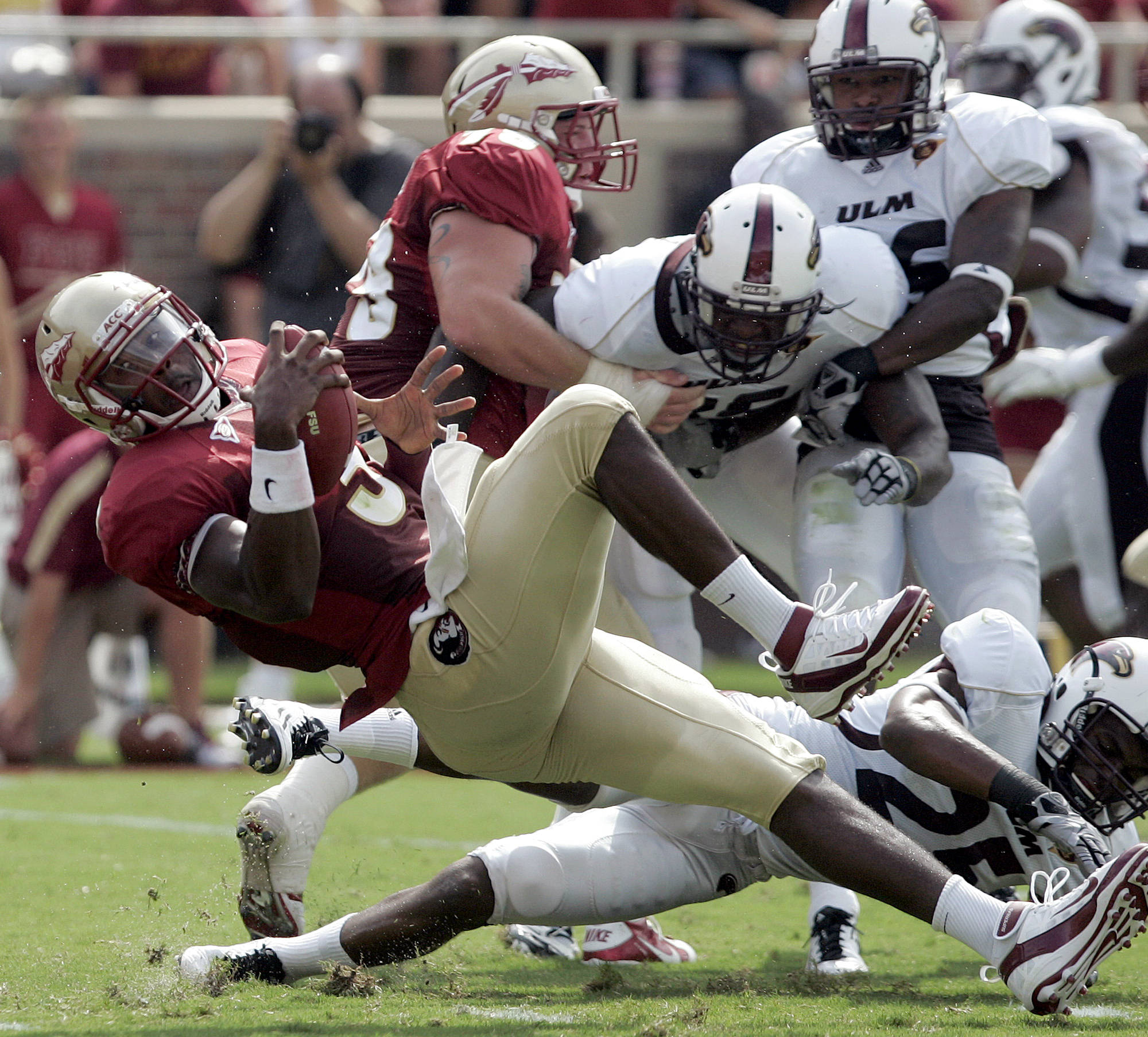 Florida State's EJ  Manuel, left, is tackled just short of the end zone by Louisiana-Monroe's Isaiah Newsome in the second quarter of a NCAA college football game on Saturday, Sept. 3, 2011, in Tallahassee, Fla. (AP Photo/Steve Cannon)