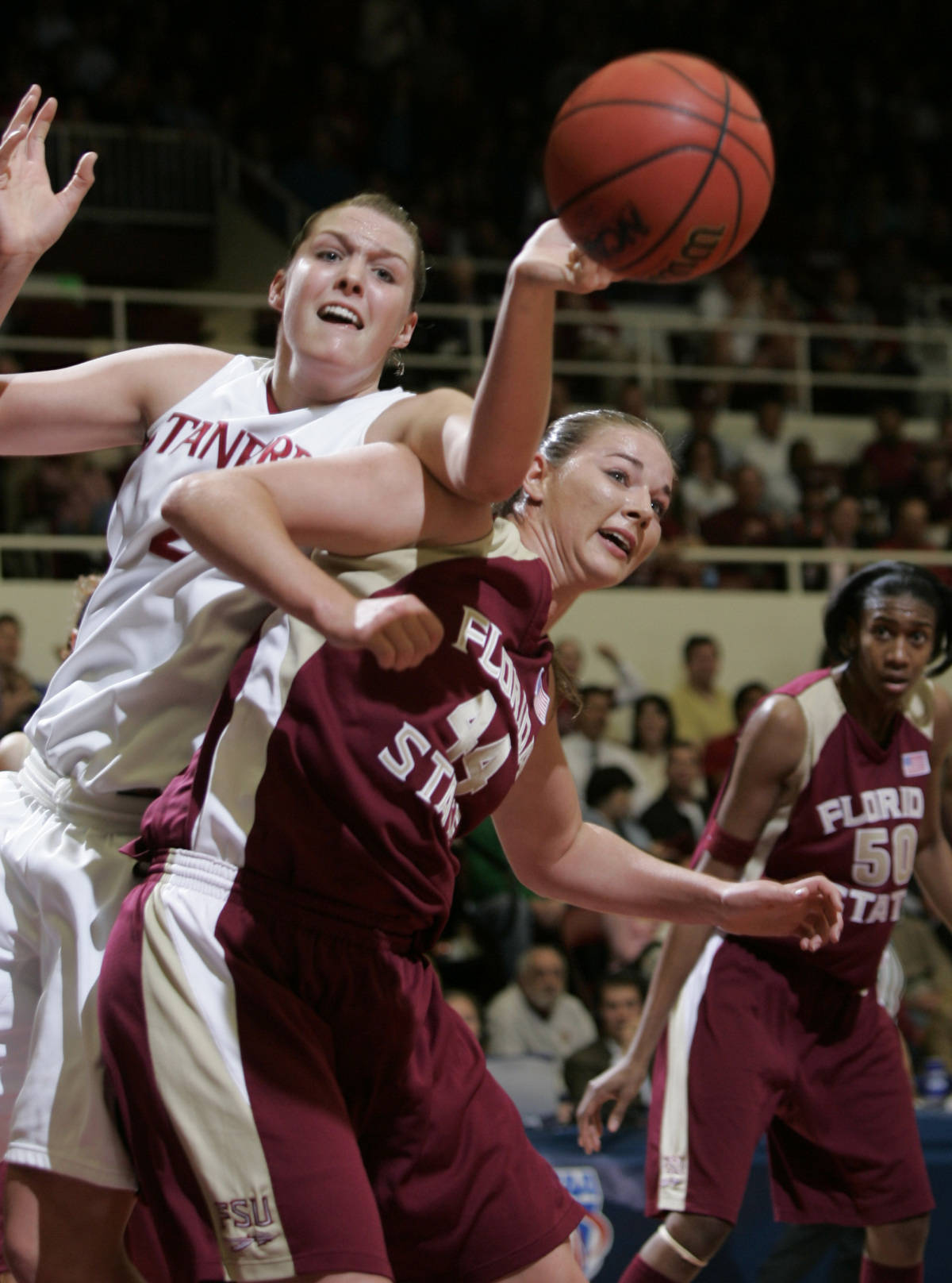 Stanford center Jayne Appel, left, and Florida State cener Nikki Anthony, right, go for a loose ball in the first half of their second-round game in the NCAA women's basketball tournament in Stanford, Calif., Monday, March 19, 2007. (AP Photo/Paul Sakuma)