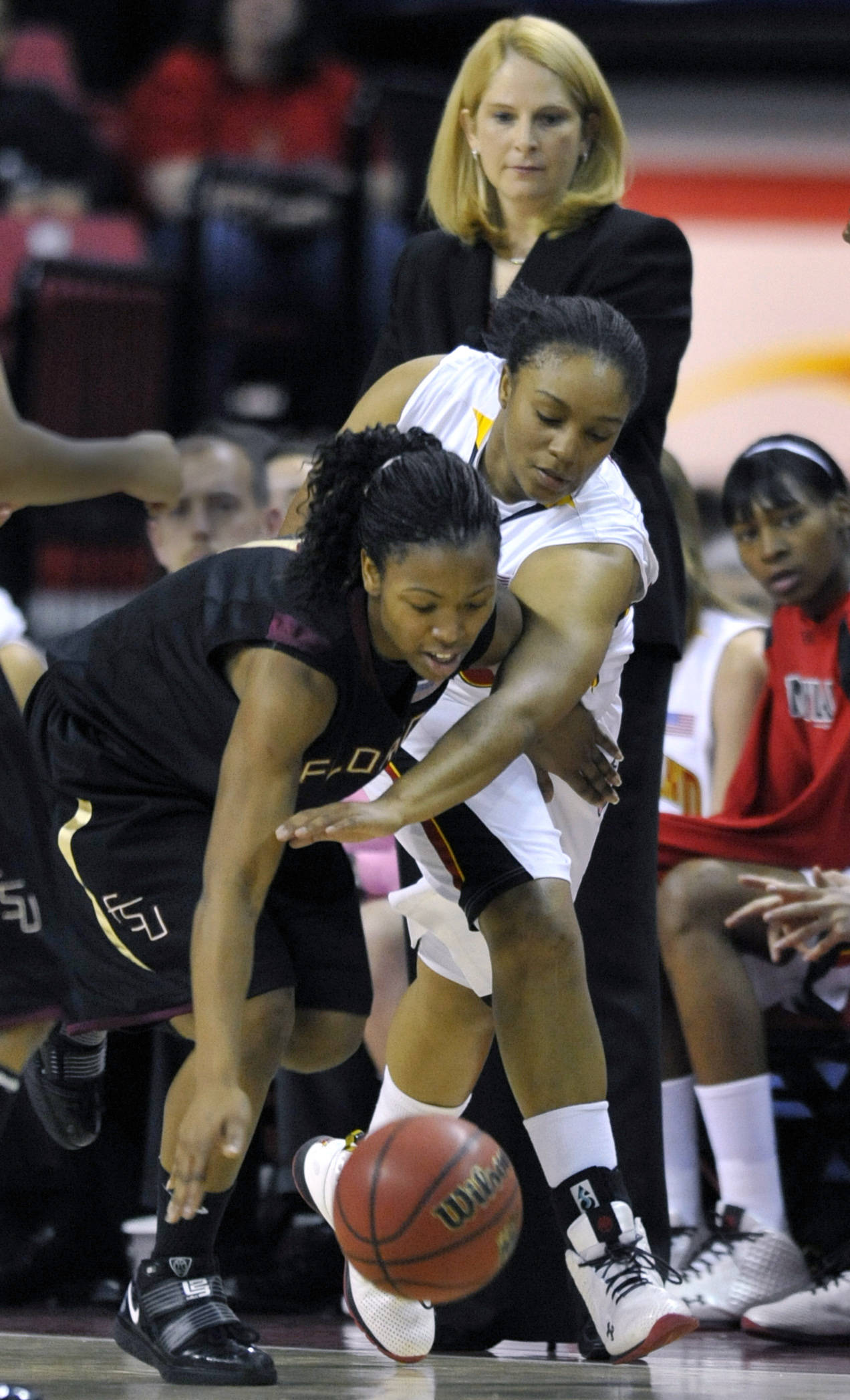 Florida State's Angel Gray and Maryland's Anjale Barrett struggle for the ball.