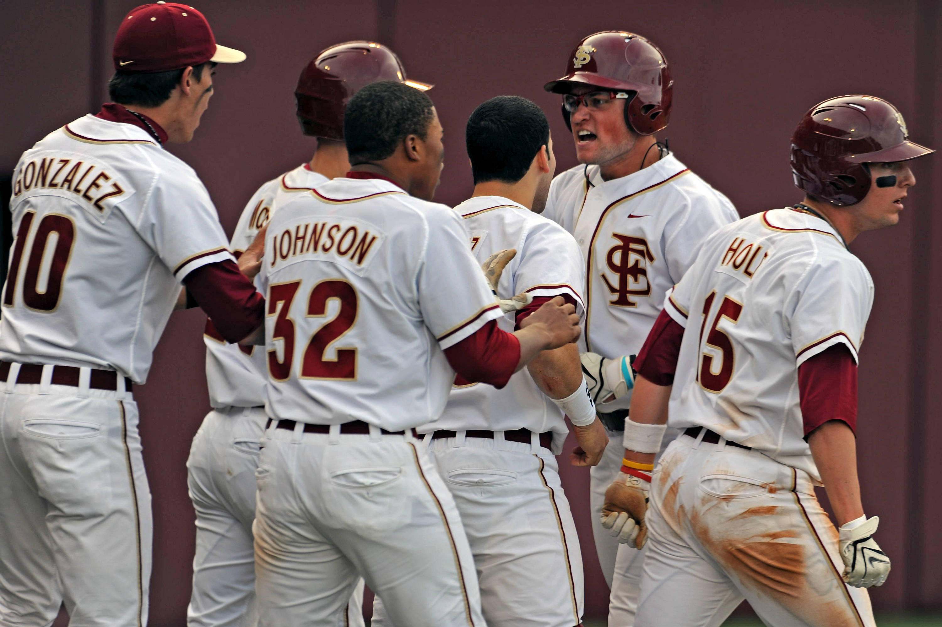 The Seminoles celebrate after scoring a run against the Panthers.