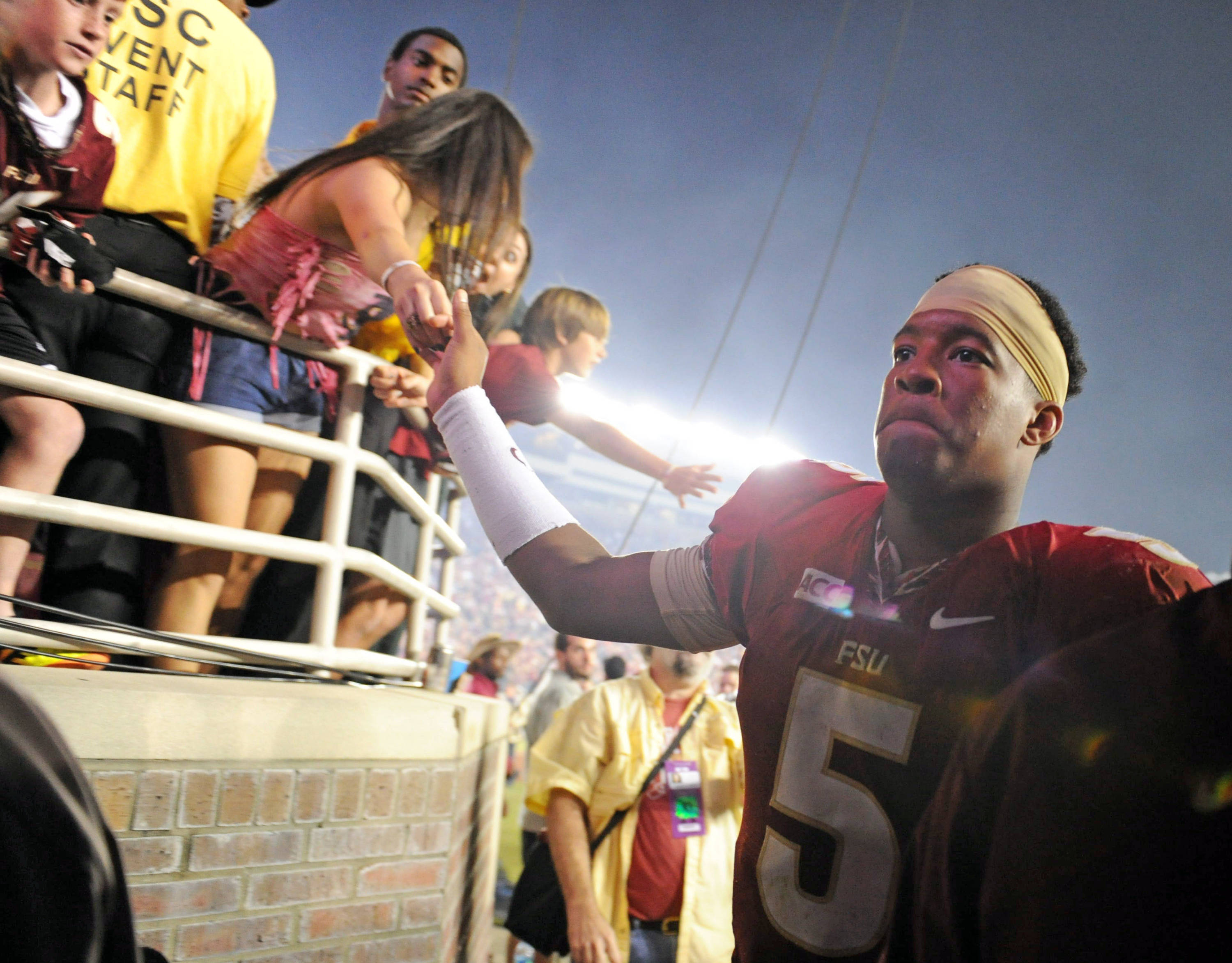 Florida State Seminoles quarterback Jameis Winston (5) greets fans after the game against the Miami Hurricanes at Doak Campbell Stadium. Mandatory Credit: Melina Vastola-USA TODAY Sports