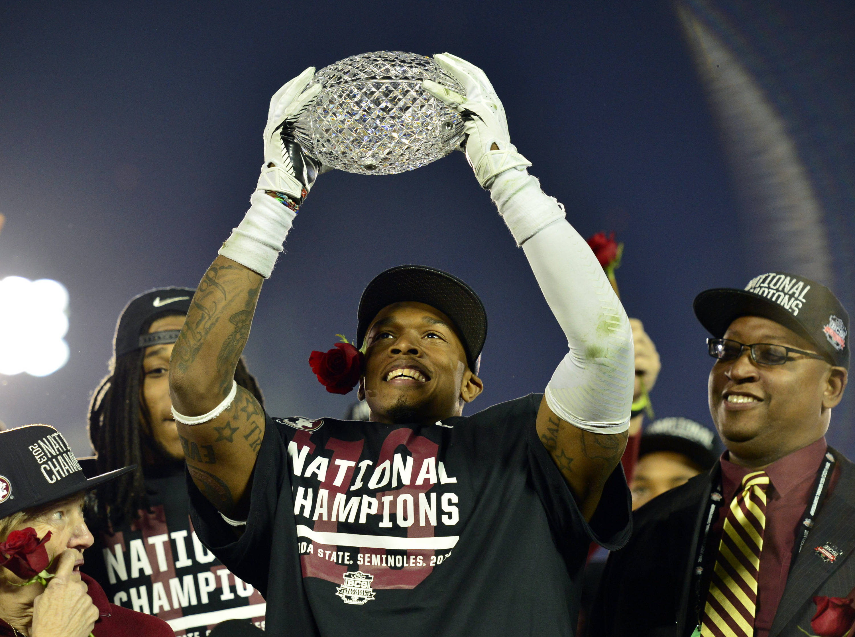 Jan 6, 2014; Pasadena, CA, USA; Florida State Seminoles defensive back P.J. Williams (26) celebrates with the Coaches Trophy after winning the 2014 BCS National Championship game against Auburn Tigers 34-31 at the Rose Bowl.  Mandatory Credit: Richard Mackson-USA TODAY Sports