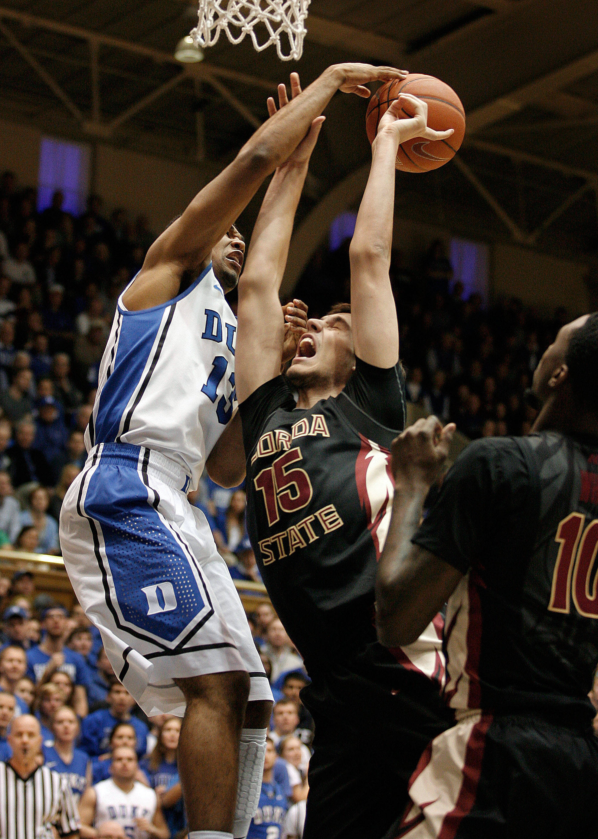 Jan 25, 2014; Durham, NC, USA; Duke Blue Devils guard Matt Jones (13) defends as Seminoles center Boris Bojanovsky (15) shoots the ball. Mark Dolejs-USA TODAY Sports