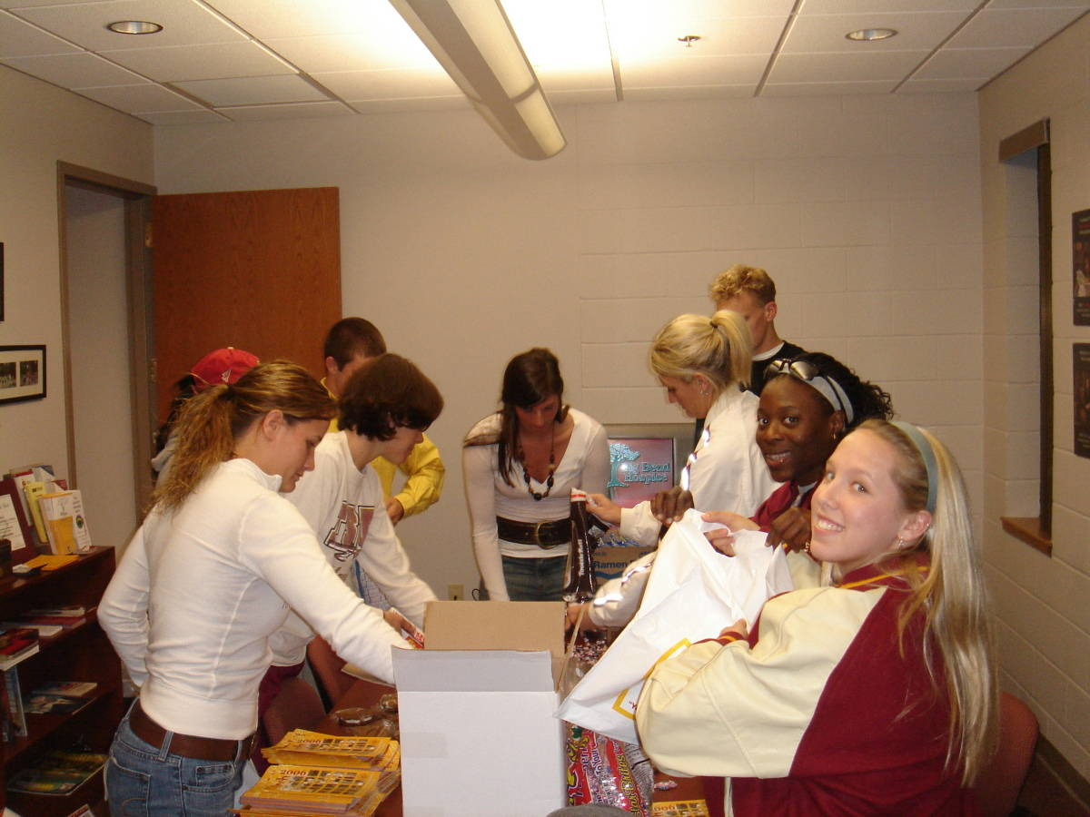 SAAC members spend some time putting together â?oefreshman final exam survival kitsâ??.