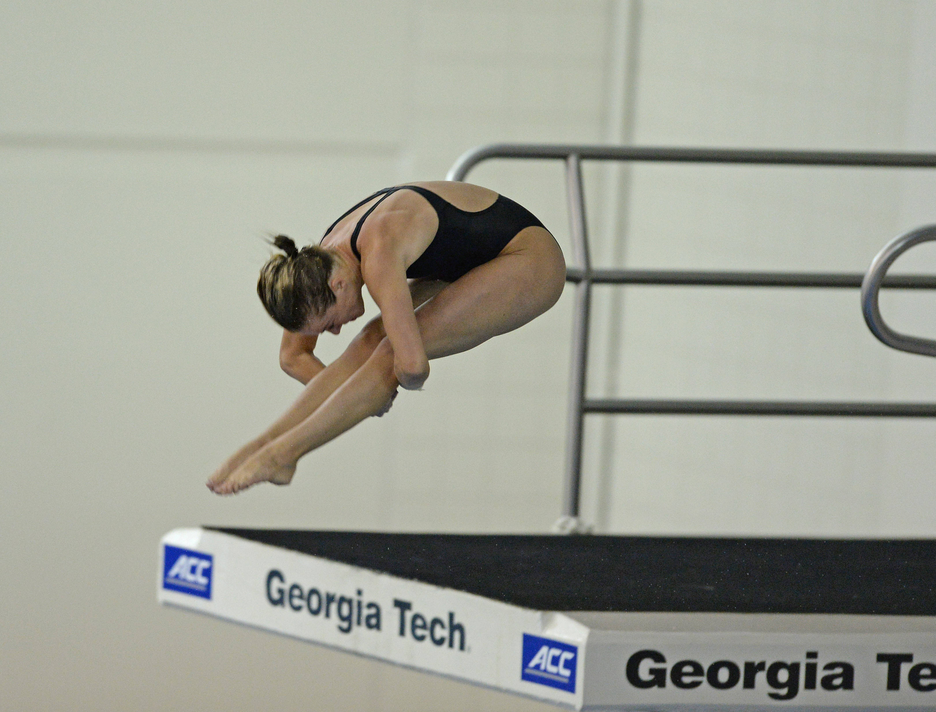 Katrina Young takes off for her front 2.5 in the platform final - Mitch White