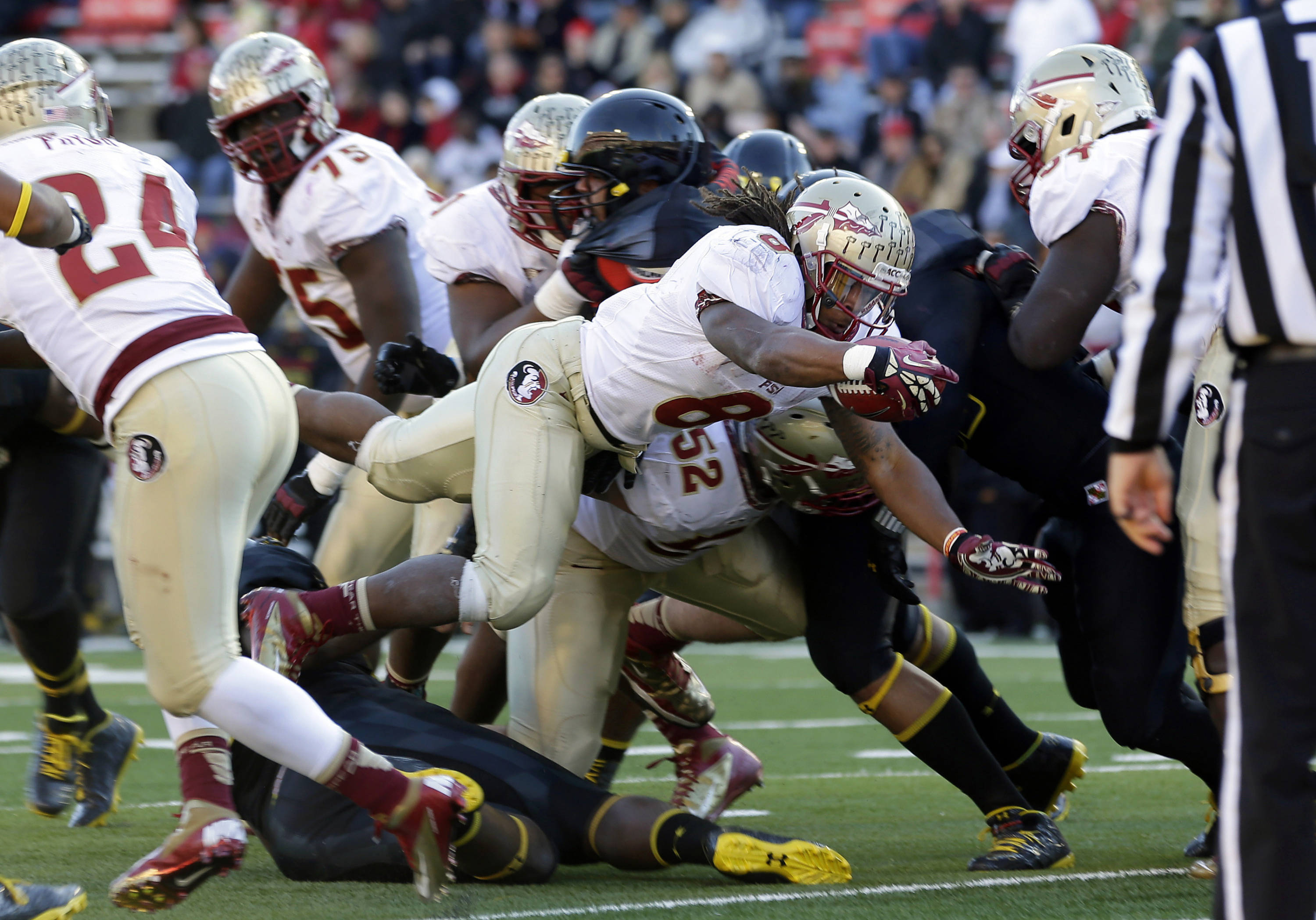 Running back Devonta Freeman dives into the end zone for a touchdown in the second half of an NCAA college football game against Maryland in College Park, Md., Saturday, Nov. 17, 2012. Florida State won 41-14. (AP Photo/Patrick Semansky)