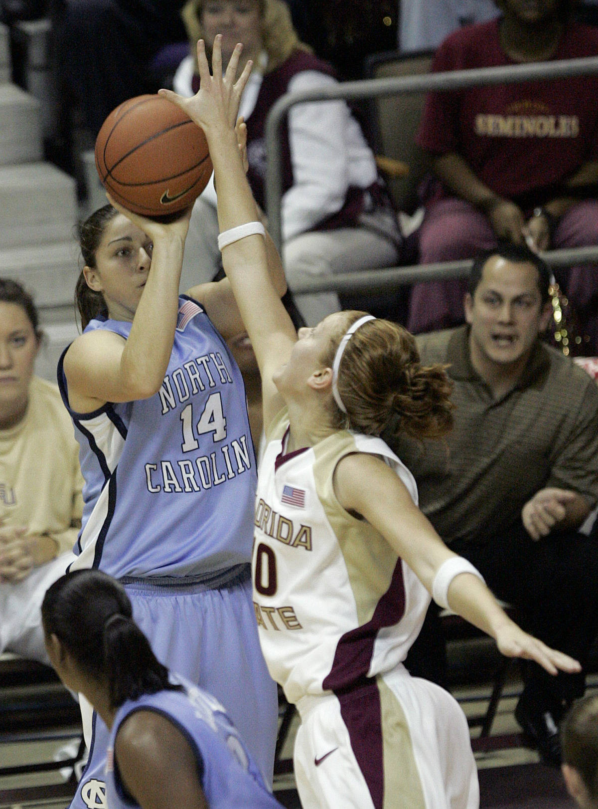 North Carolina's Heather Claytor (14) shoots a three over Florida State's Mara Freshour in the first half of a college basketball game on Monday, Feb. 12, 2007 in Tallahassee, Fla. (AP Photo/Steve Cannon)
