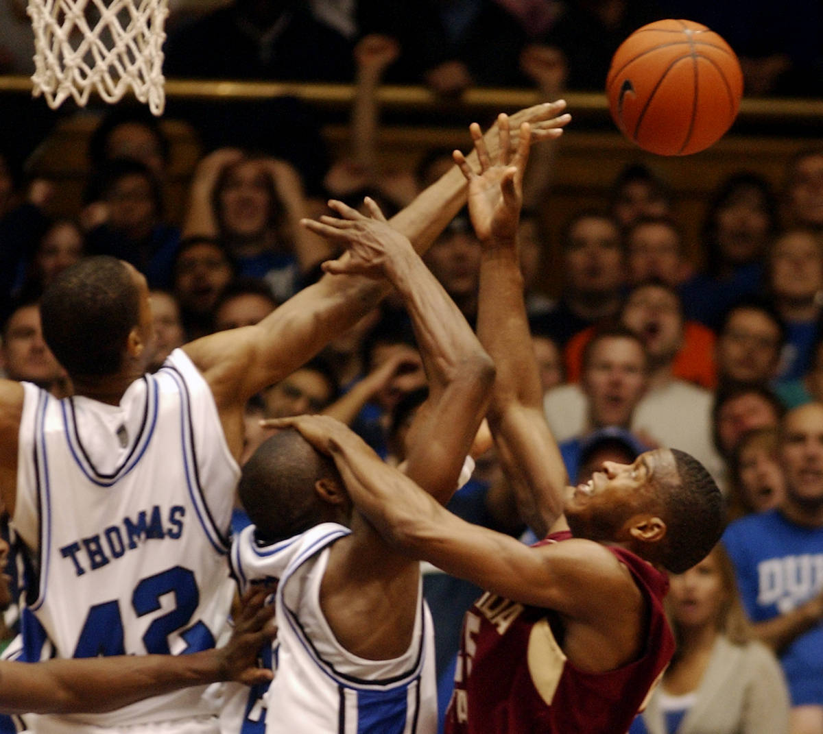Florida State's Jason Rich, right, battles for a rebound over Duke's Lance Thomas (42) and DeMarcus Nelson, center, in the second half of a basketball game in Durham, N.C., on Sunday, Feb. 4, 2007. Florida State upset Duke, 68-67. (AP Photo/Sara D. Davis)