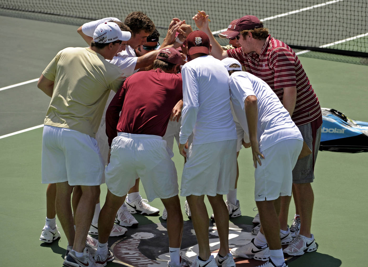 The men's tennis team cheers before the match.