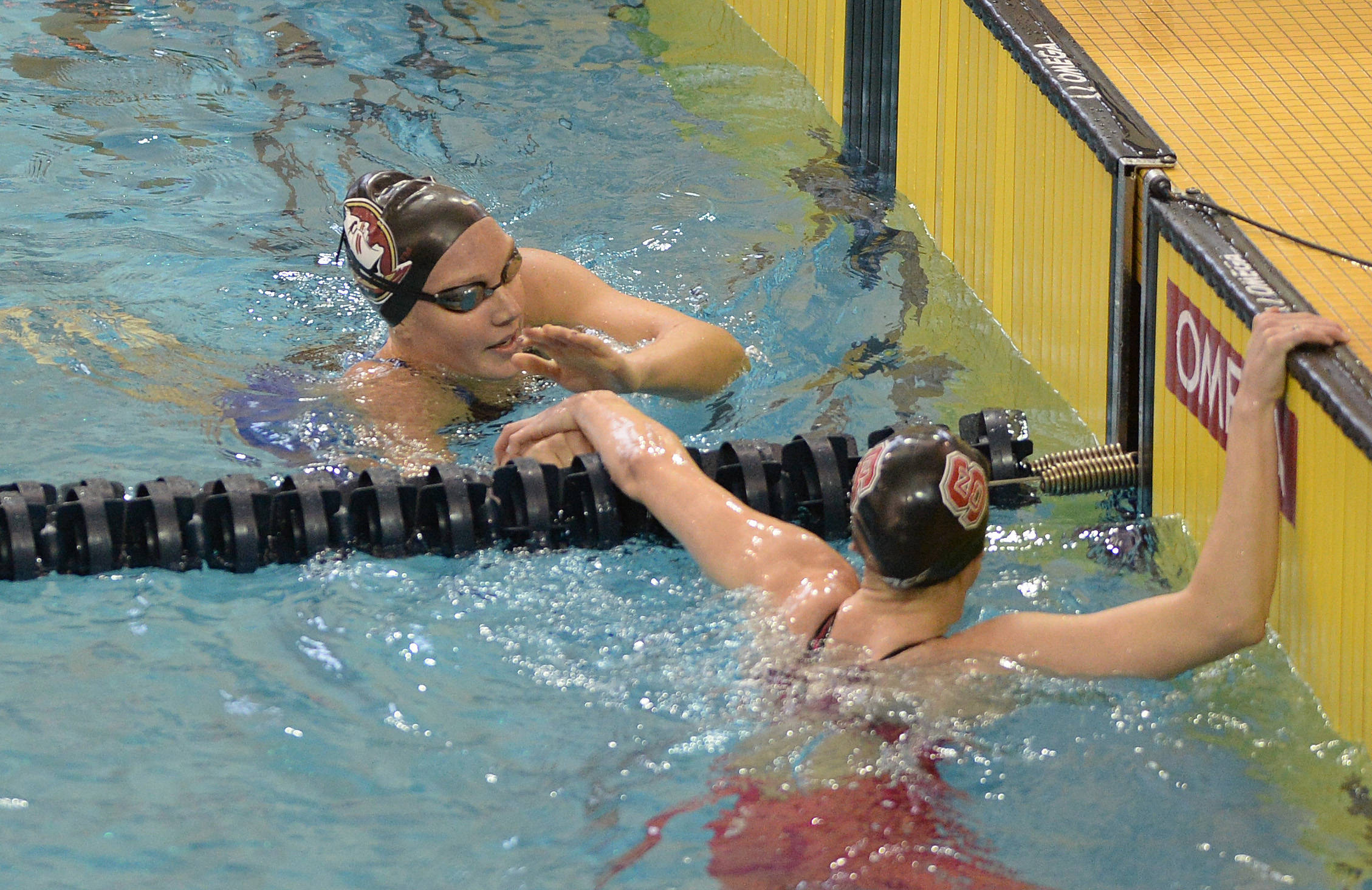 Kaitlyn Dressel shakes hands after the 200 free - Mitch White