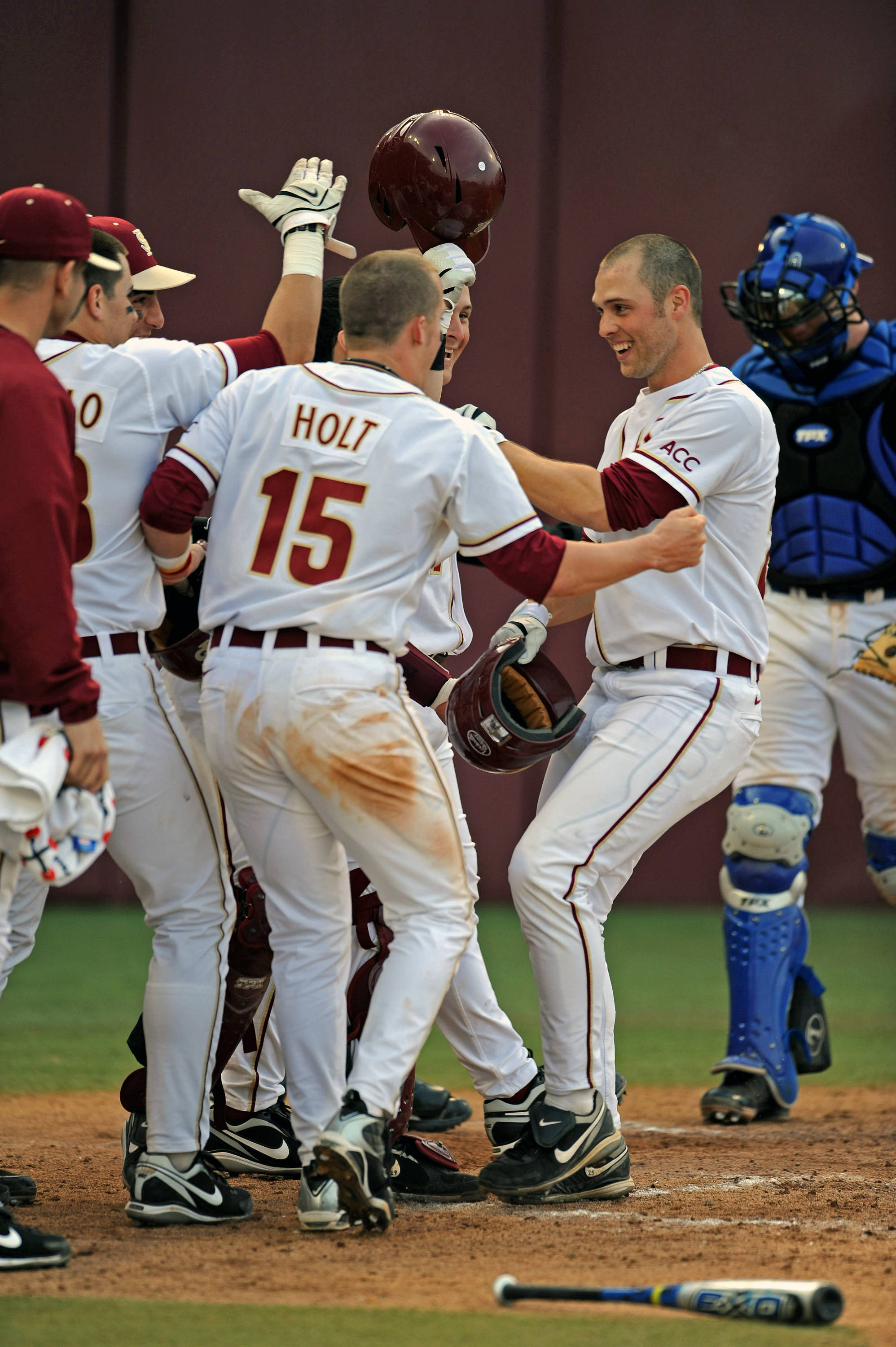 Mike McGee celebrates with teammates after going yard for the first Seminole home run of the season.