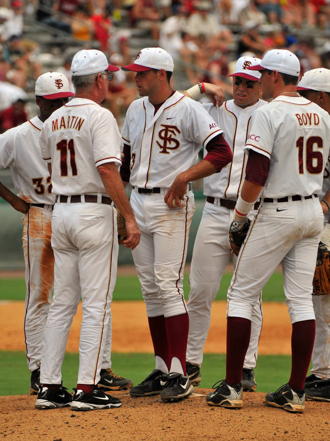 Head coach Mike Martin meets with FSU starting pitcher Sean Gilmartin and the rest of the Seminole infielders at the mound.