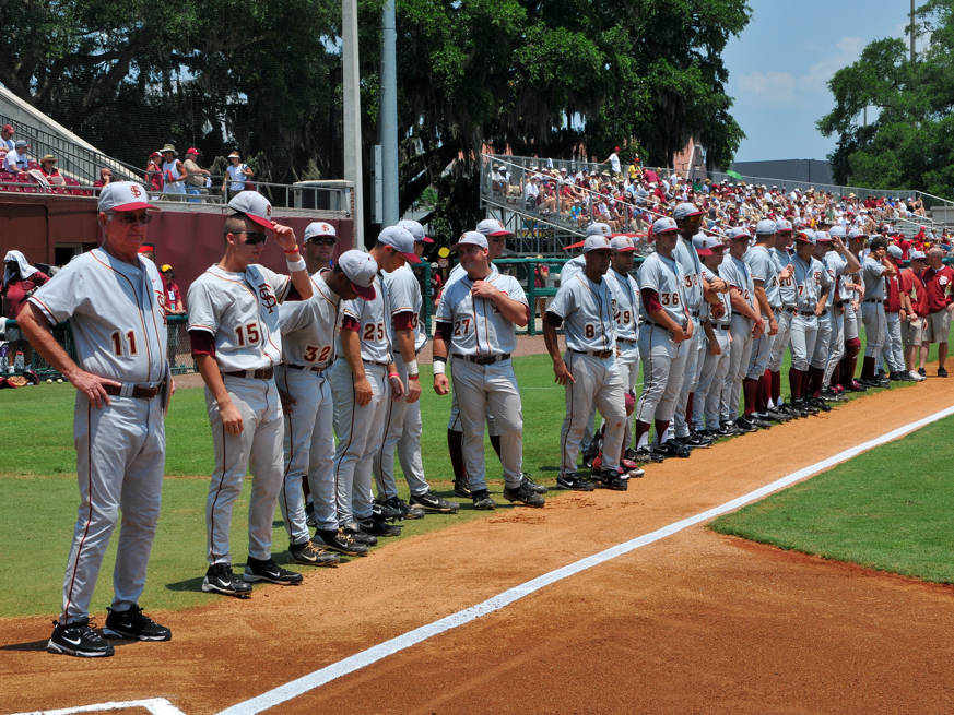 The Seminoles line-up along the third base line during the pre-game introductions.