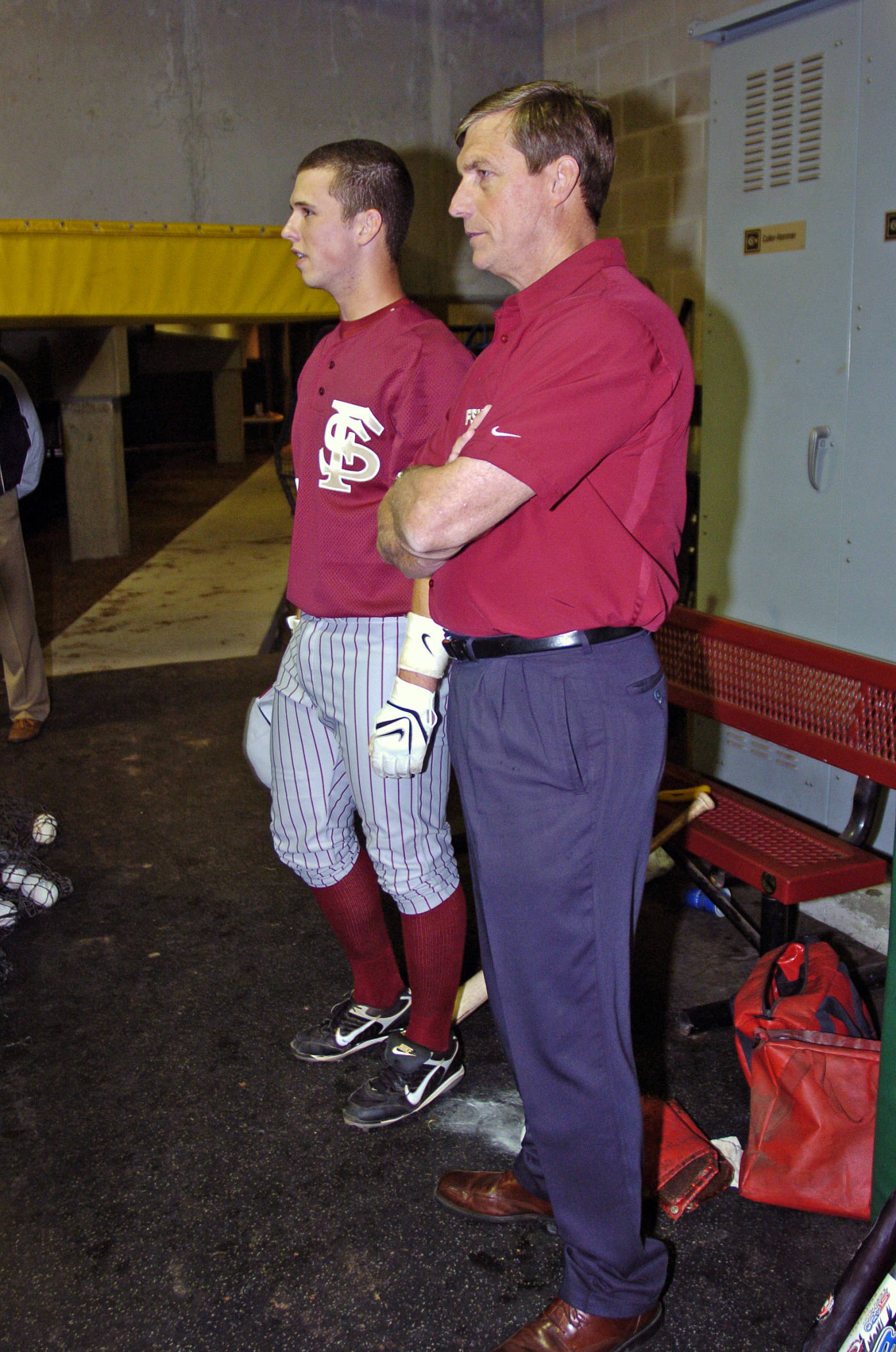 FSU Athletics Director Randy Spetman talks with catcher Buster Posey while the Seminoles take pregame batting practice in the cage.