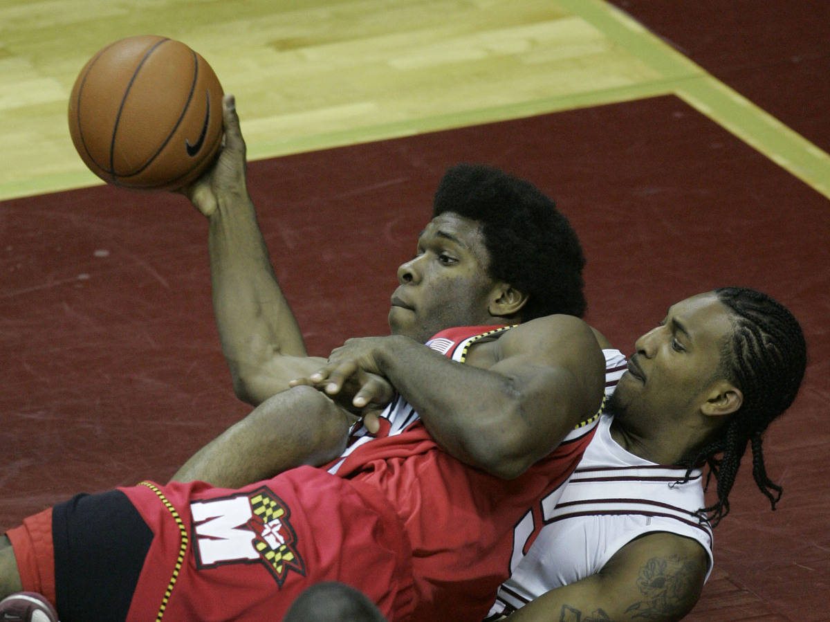 Maryland's Bambale Osby, top, and Florida State's Ryan Reid battle on the floor for a loose ball during the second half of a college basketball game Tuesday, Jan. 30, 2007, in Tallahassee, Fla. Florida State won 96-79. (AP Photo/Phil Coale)