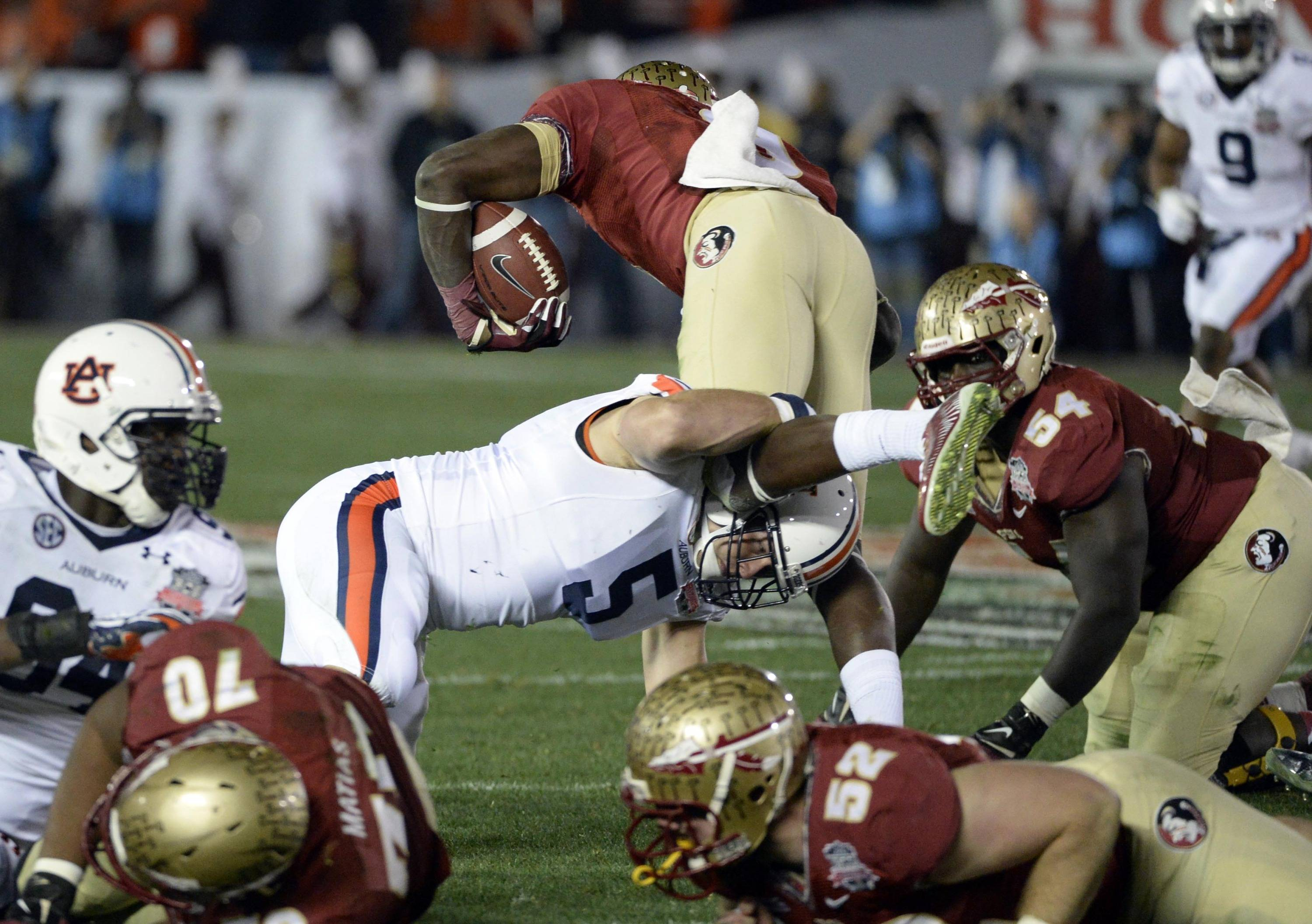 Jan 6, 2014; Pasadena, CA, USA; Auburn Tigers linebacker Jake Holland (5) tackles Florida State Seminoles running back Karlos Williams (9) during the first half of the 2014 BCS National Championship game at the Rose Bowl.  Mandatory Credit: Richard Mackson-USA TODAY Sports