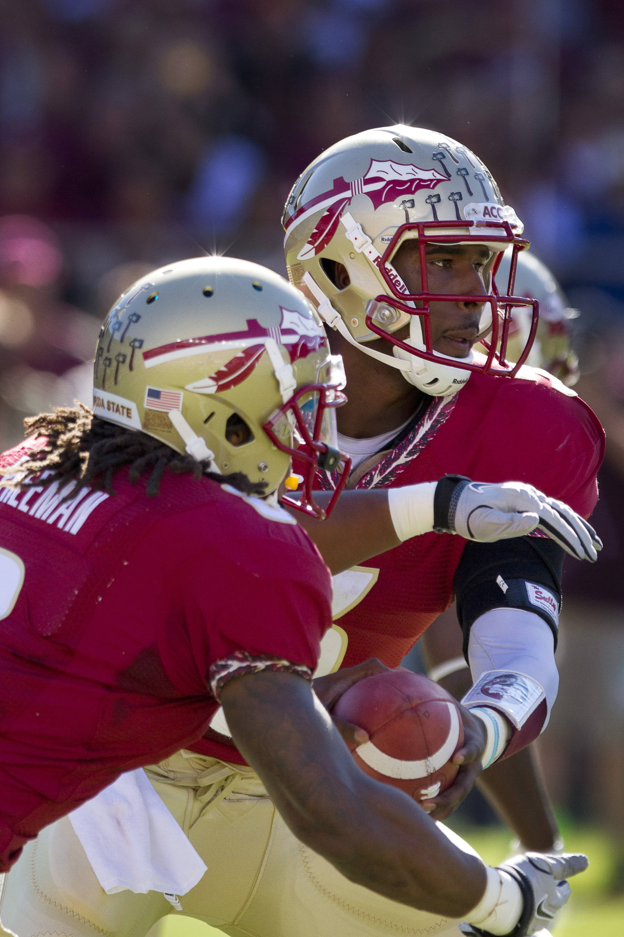 EJ Manuel (3) hands the ball off to  EJ Manuel (3), Devonta Freeman (8) during the football game against Maryland in Tallahassee, Florida on October 22, 2011.