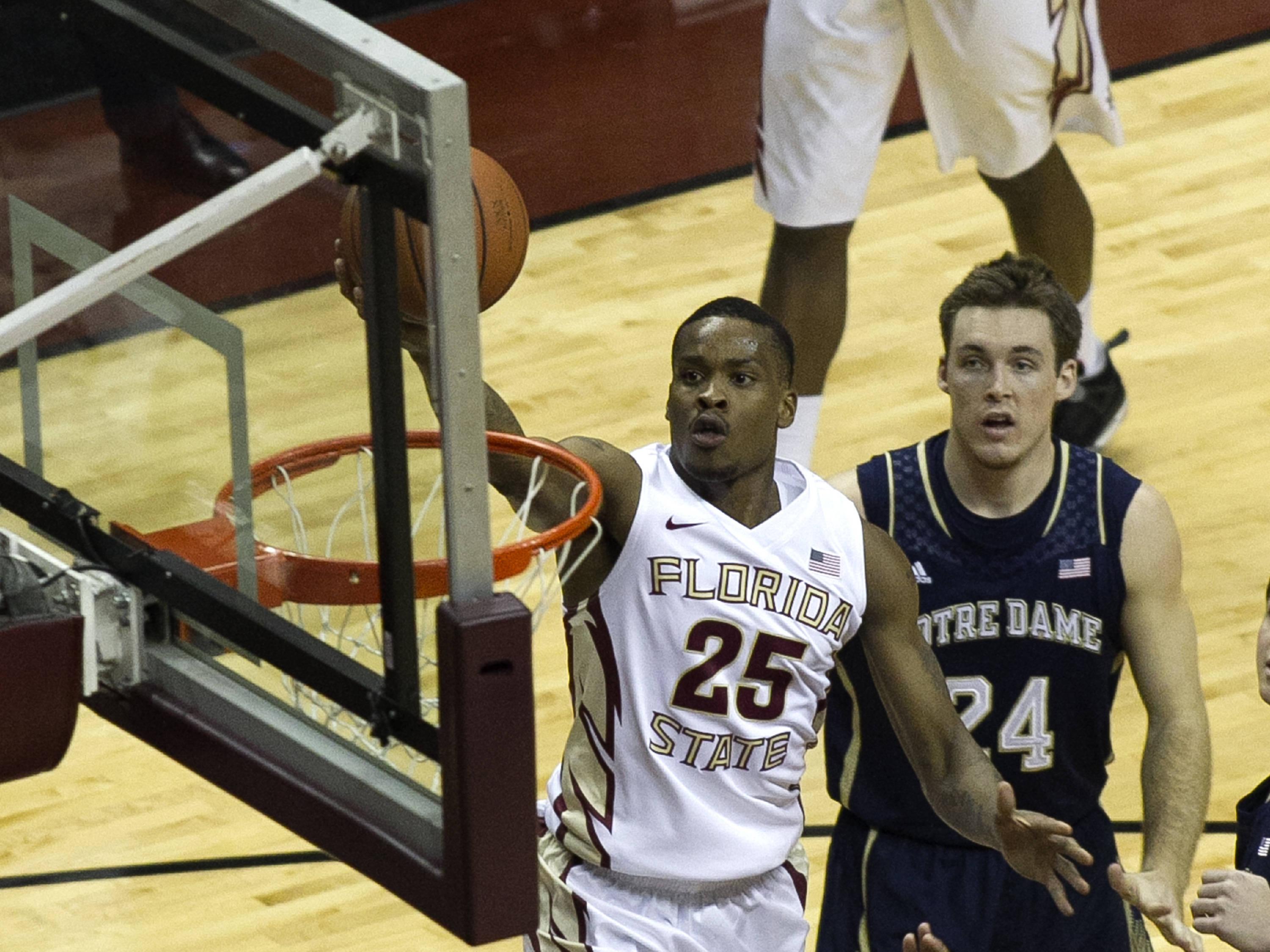 Aaron Thomas (25) goes high for a lay-up, FSU vs Notre Dame, 1-21-14, (Photo's by Steve Musco)