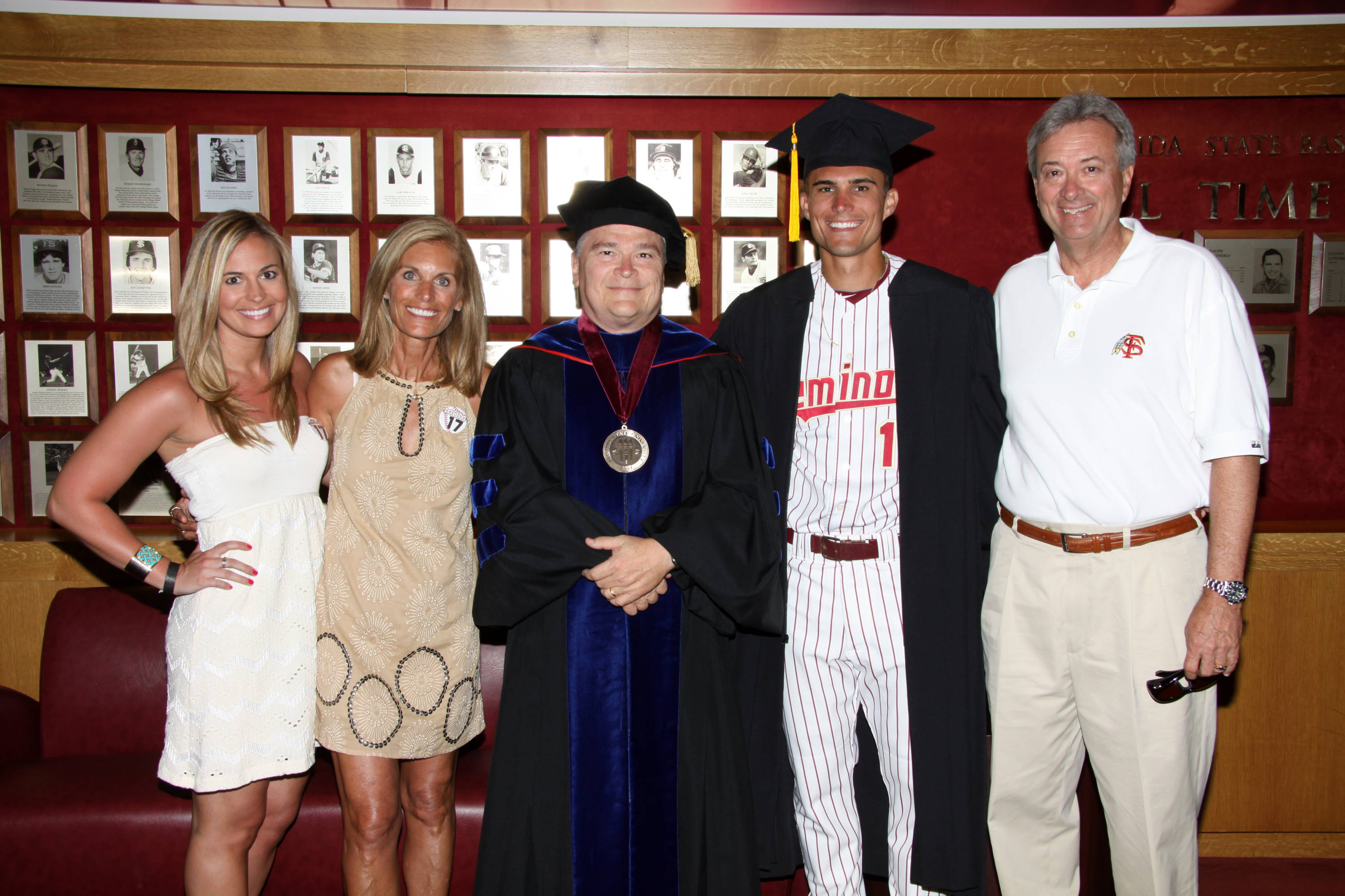 2011 Spring Graduation Ceremony held at Dick Howser Stadium to honor the graduating baseball seniors. Robby Stahl (17) with family and President Barron