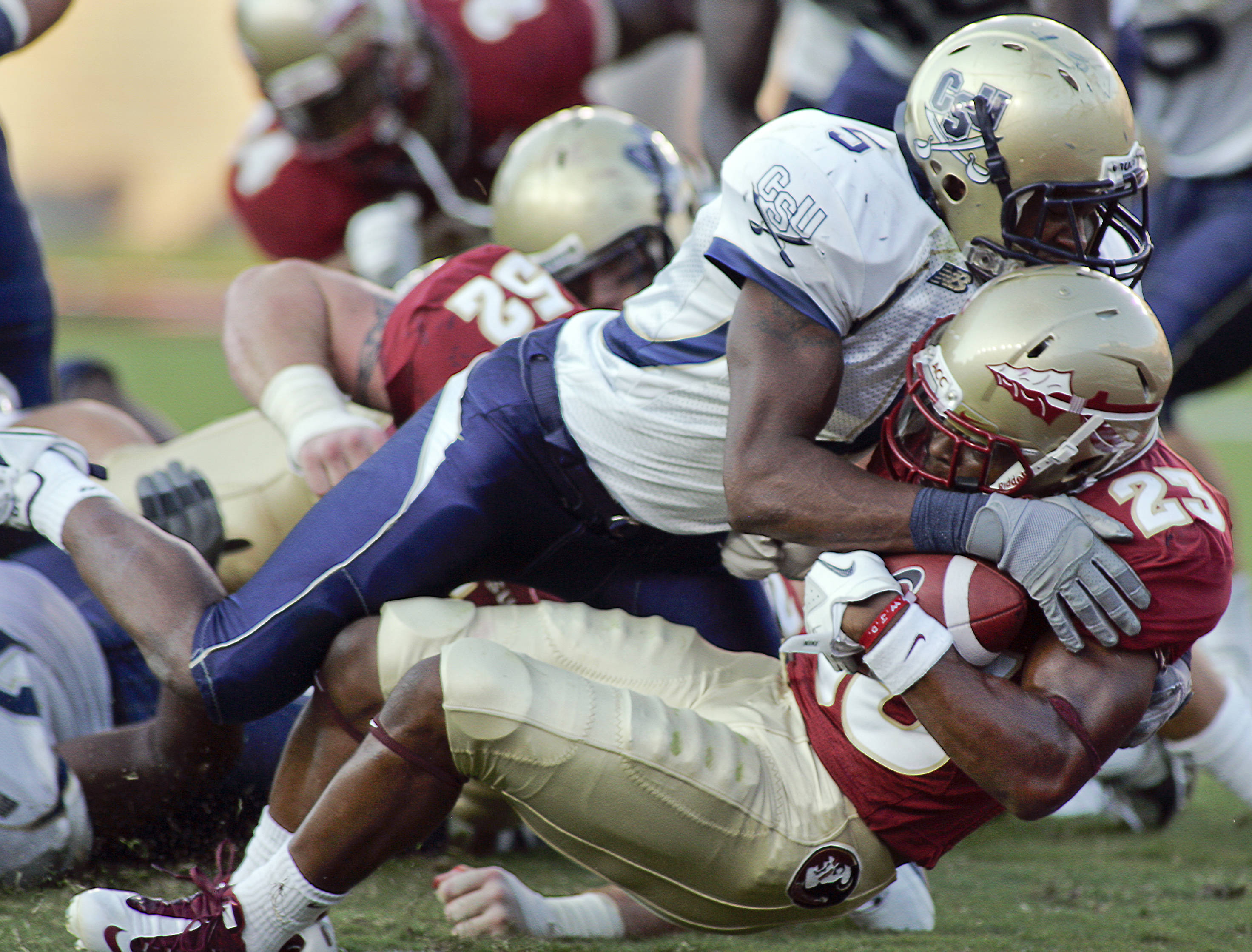 Florida State's running back Chris Thompson (23) dives into the endzone for a two-yard touchdown as Charleston Southern's defensive back Demaris Freeman (5) tries to stop him in the second quarter of an NCAA college football game on Saturday, Sept. 10, 2011, in Tallahassee, Fla. (AP Photo/Phil Sears)