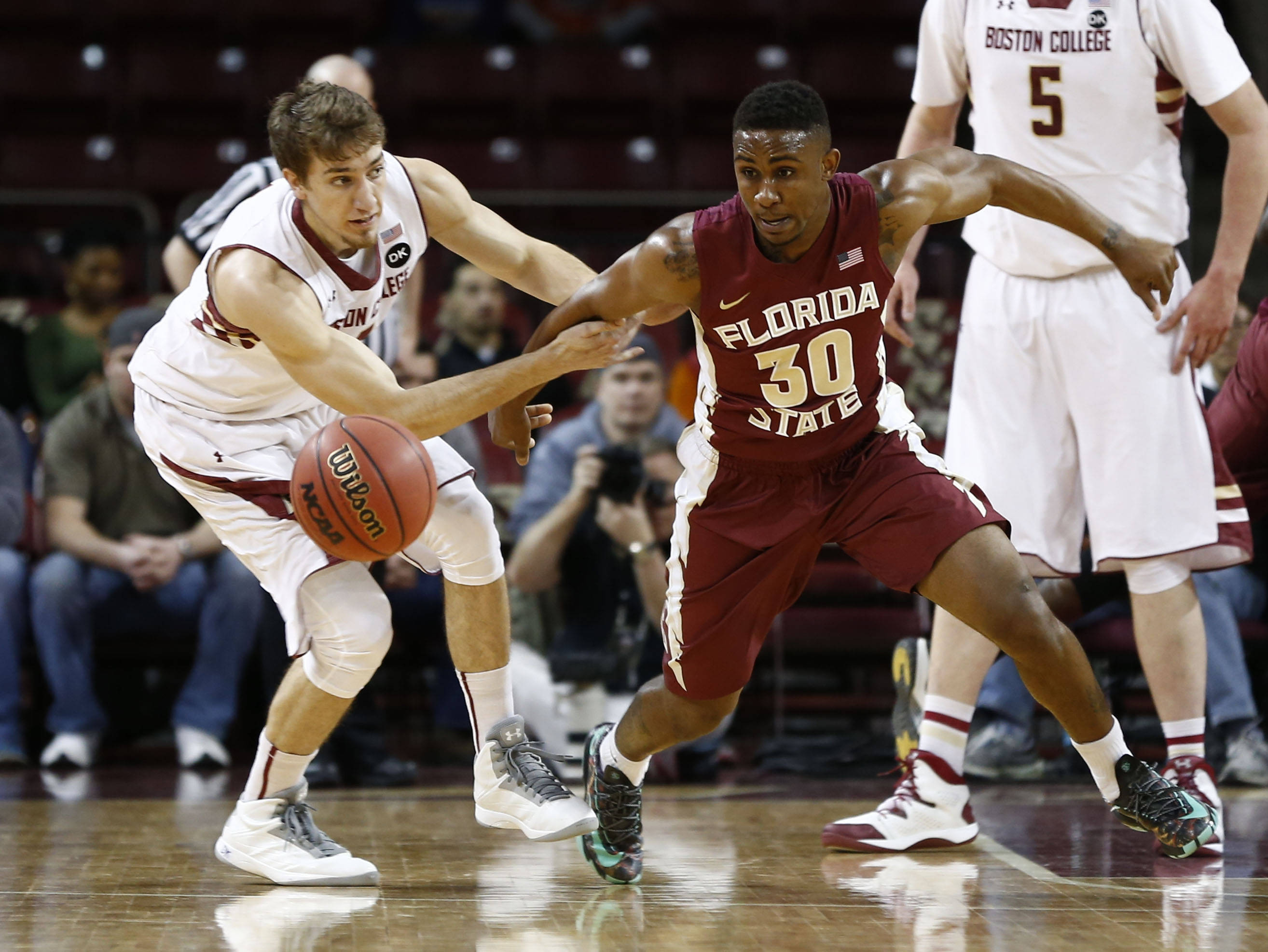 Mar 4, 2014; Chestnut Hill, MA, USA; Boston College Eagles forward Eddie Odio (left) and Seminoles guard Ian Miller (30) battle for a loose ball during the first half. Mark L. Baer-USA TODAY Sports