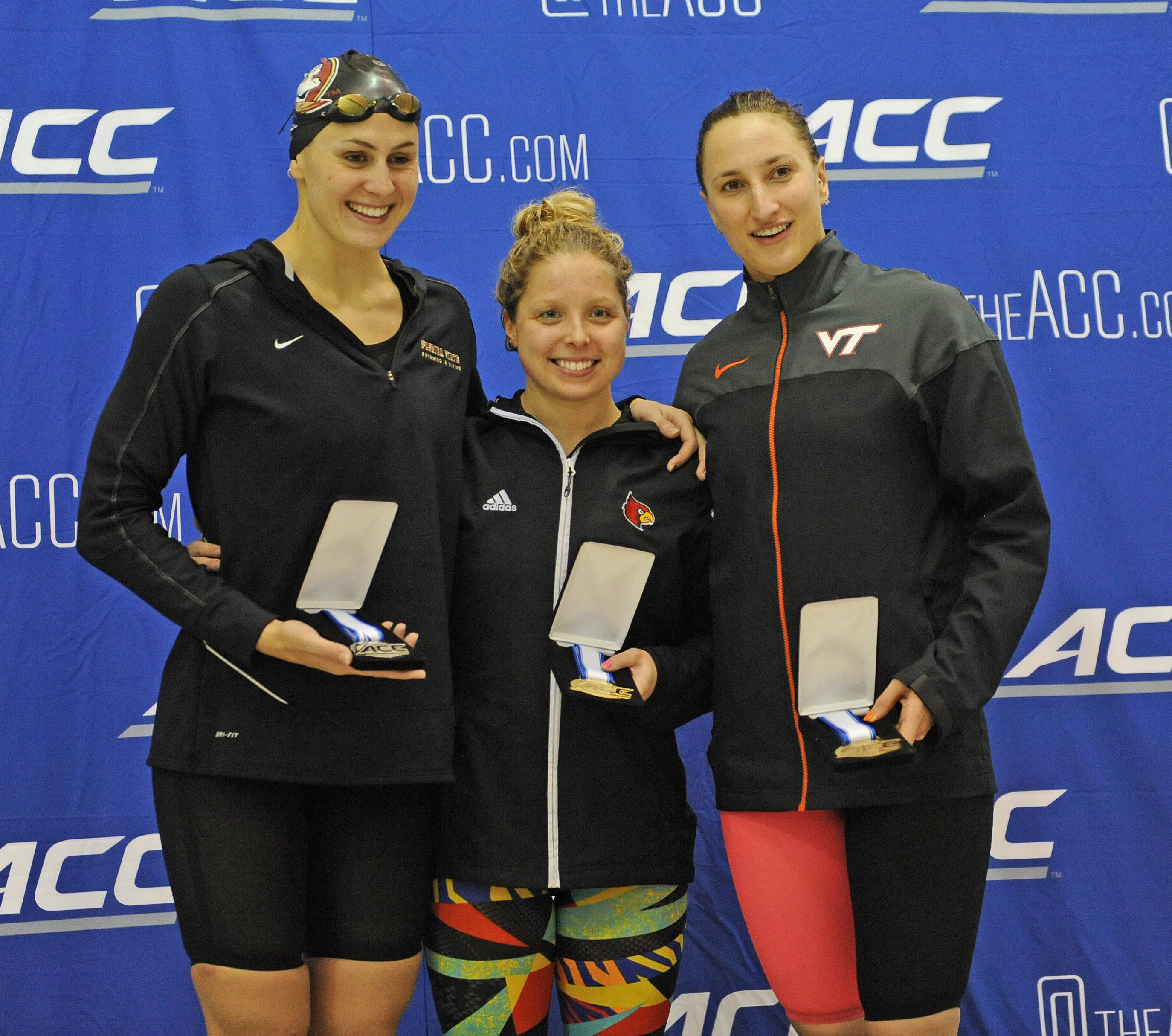 Chelsea Britt wins silver in the 200 fly and poses with the medalists - Mitch Whtie