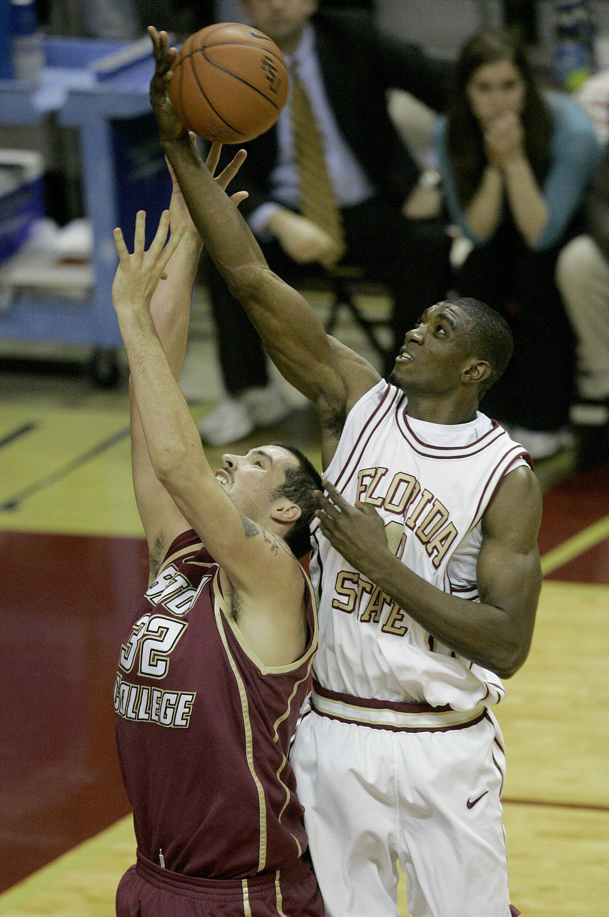 Florida State's Uche Echefu, right, goes over the back of Boston College's John Oates for a first-half rebound, Sunday, Feb. 11, 2007, in Tallahassee, Fla.(AP Photo/Phil Coale)