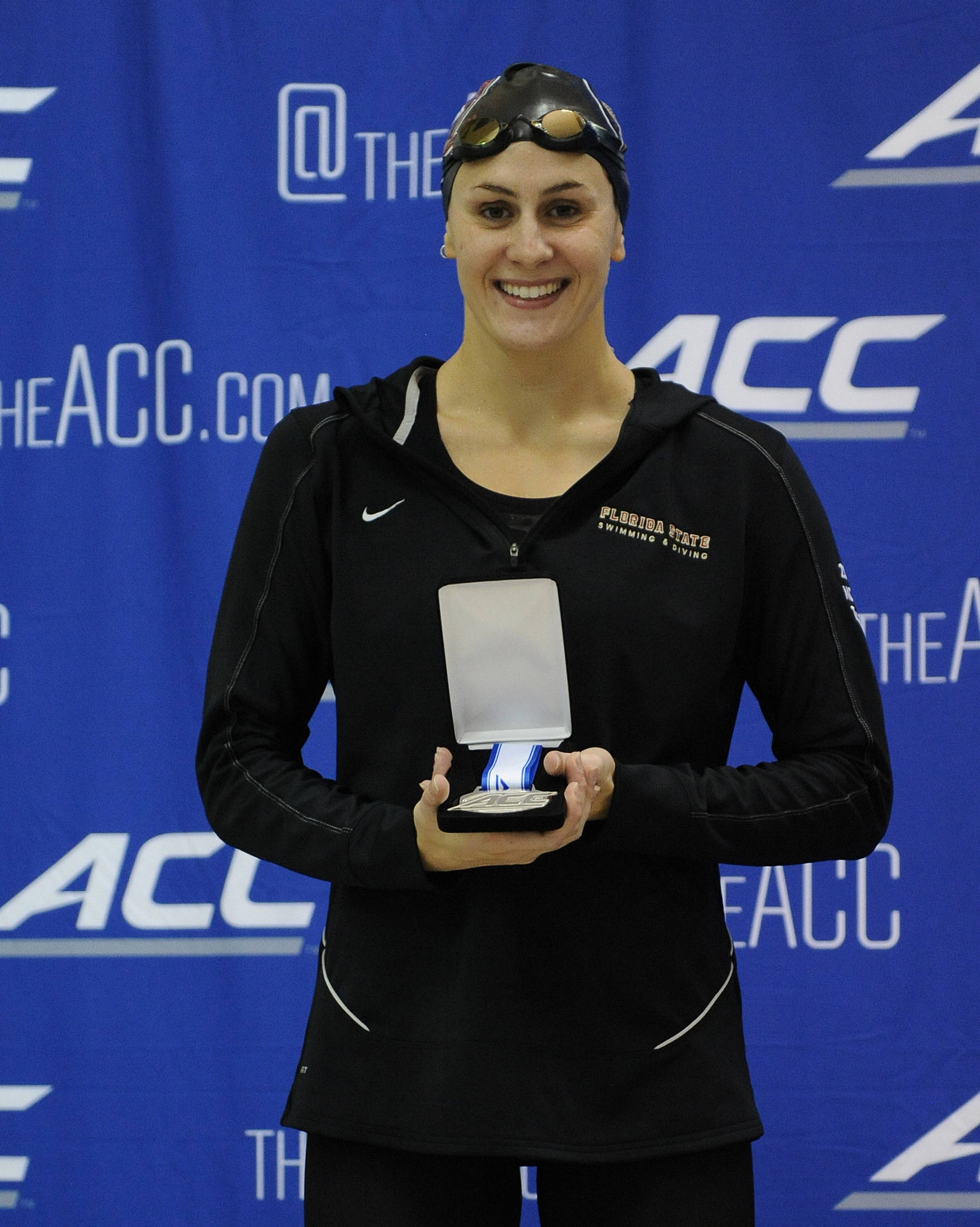 Chelsea Britt smiles with her 100 fly silver - Mitch White