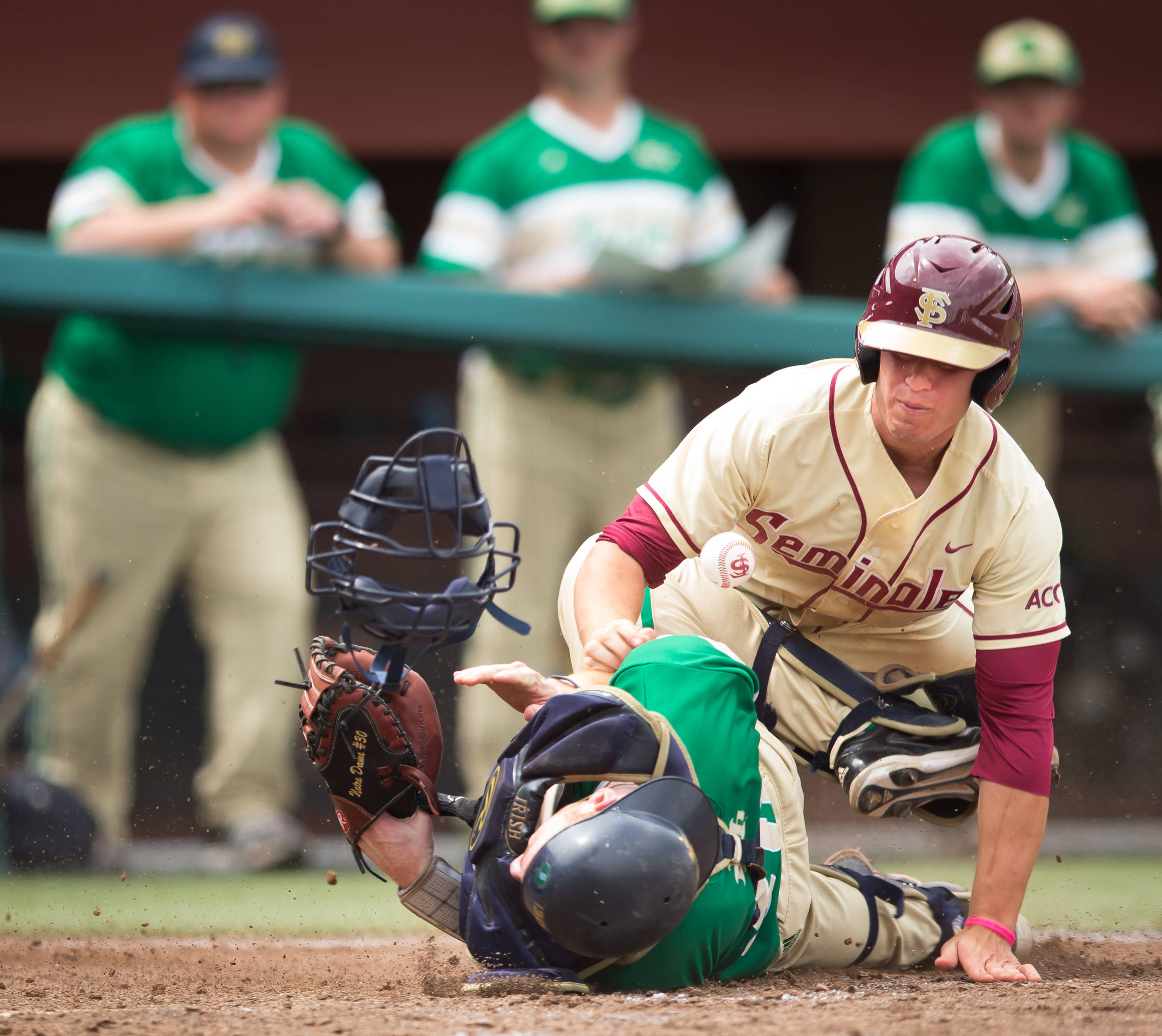 Josh Delph (2) scores after colliding with the Notre Dame catcher.