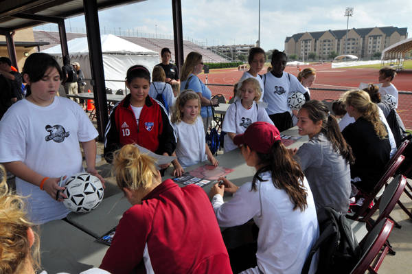 The Seminoles during the Youth Clinic Autograph Session