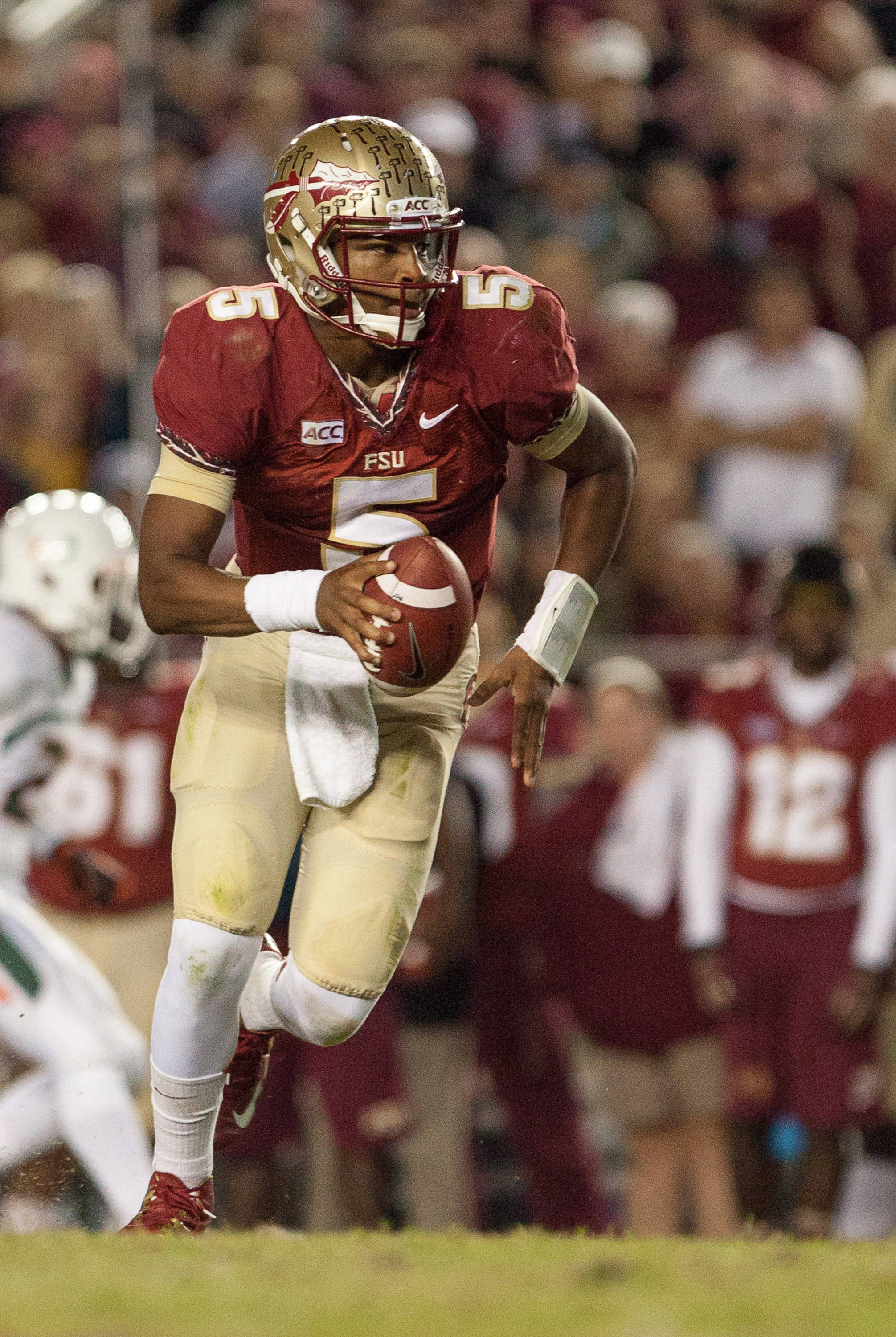 Jameis Winston (5) handles the ball during FSU football's 41-14 win over Miami on Saturday, November 2, 2013 in Tallahassee, Fla. Photo by Michael Schwarz.