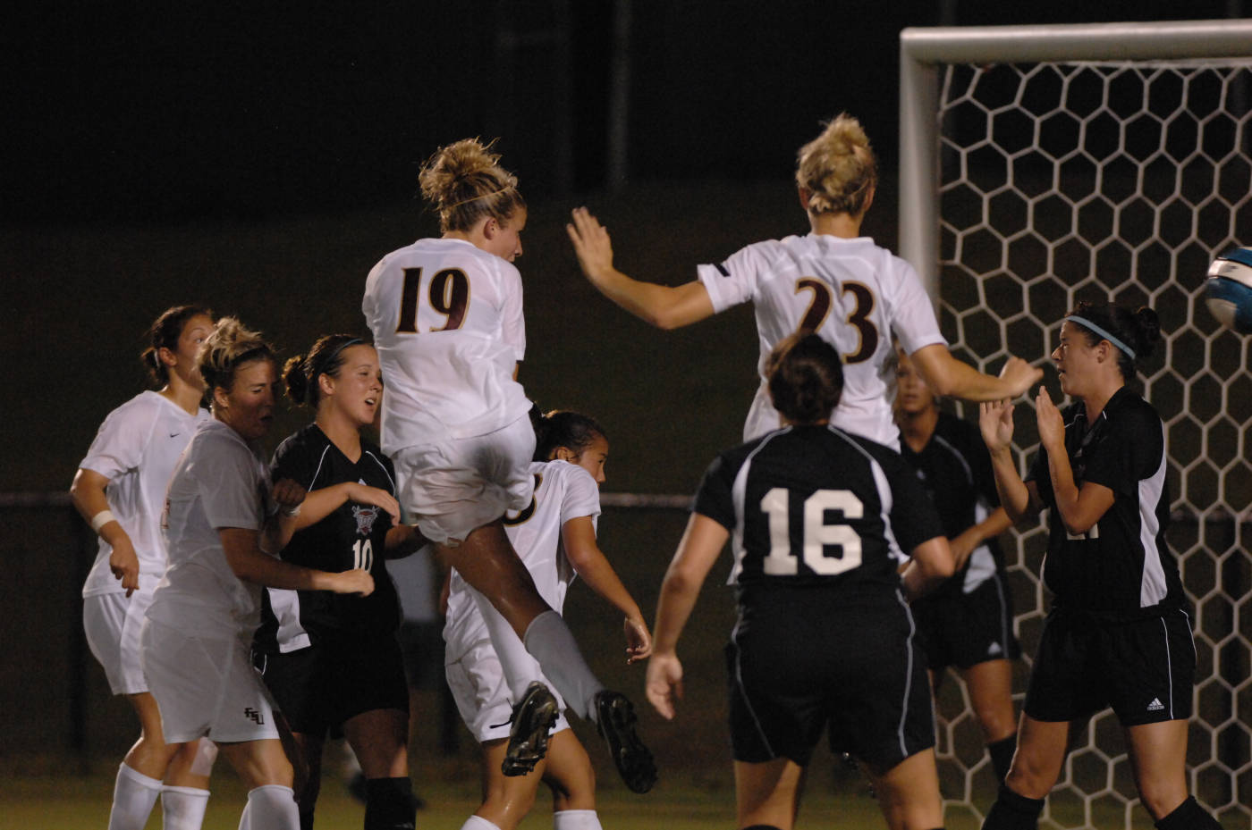 Becky Edwards scores her second goal of the evening on a header shot off a corner kick by sophomore Annie Stalzer.